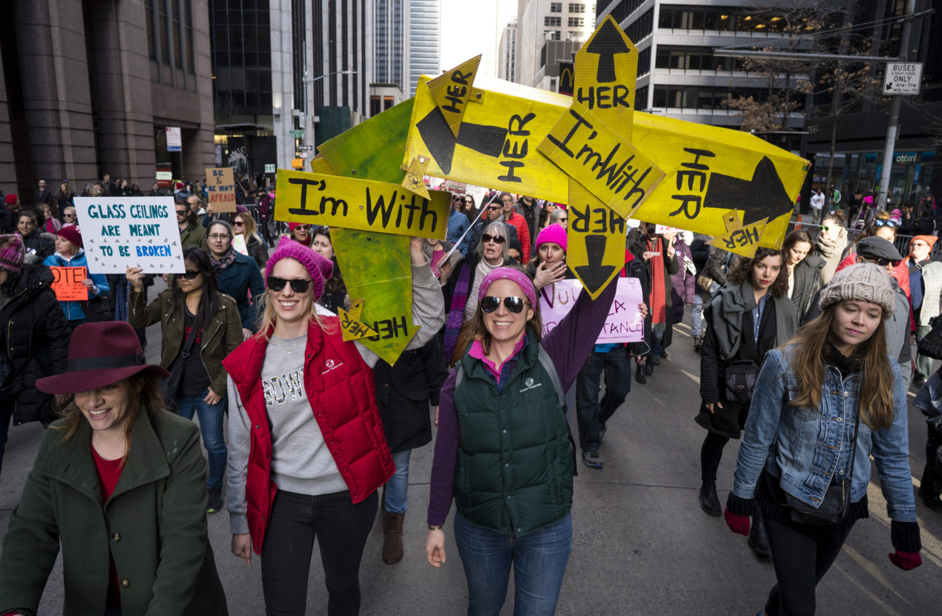 Two women hold an I'm with her sign in New York ( Craig Ruttle/AP)