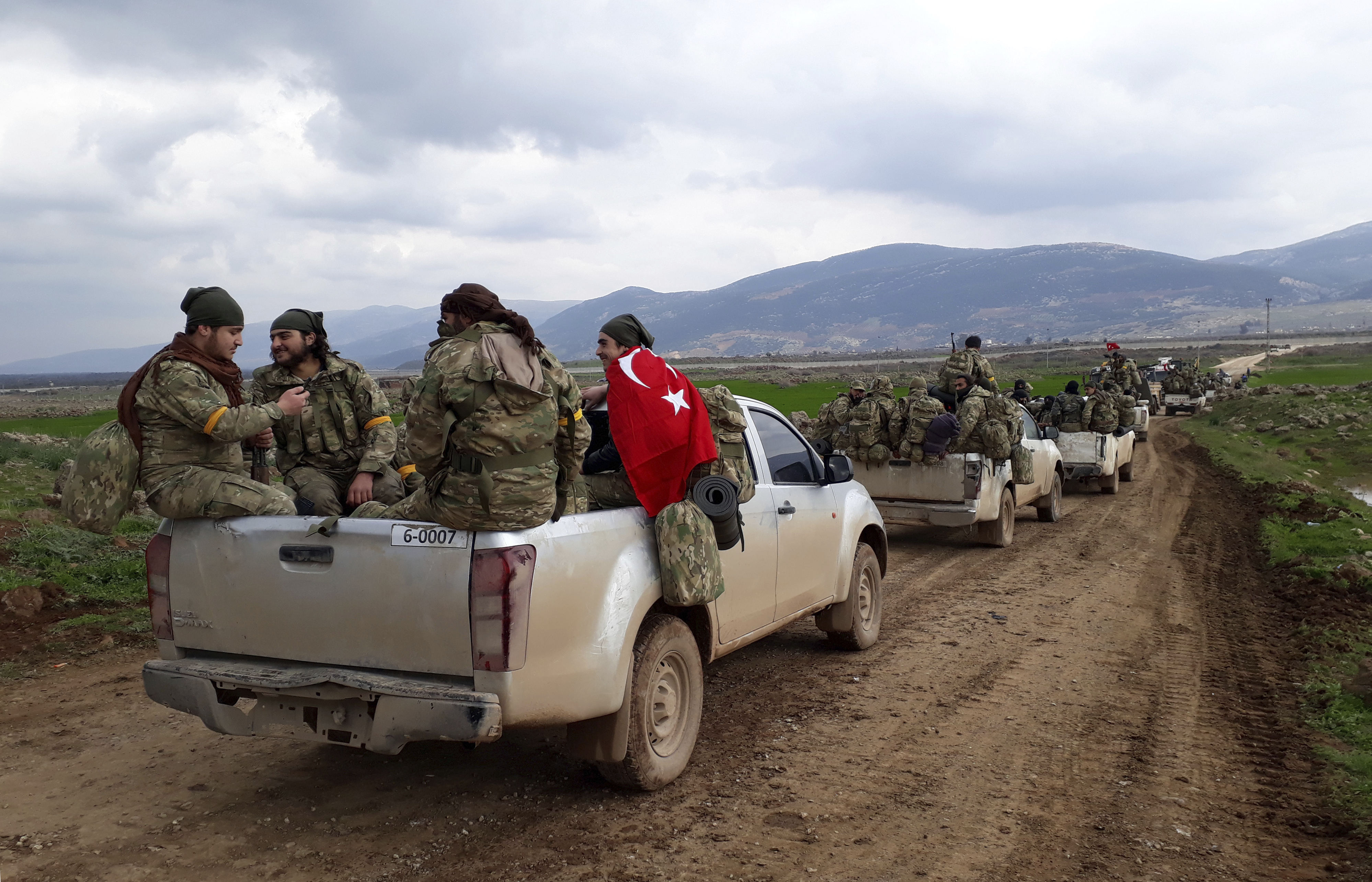 Turkey-backed Free Syrian Army fighters head towards the Syrian border in Kirikhan, Turkey (Furkan Arslanoglu/Depo Photos via AP)