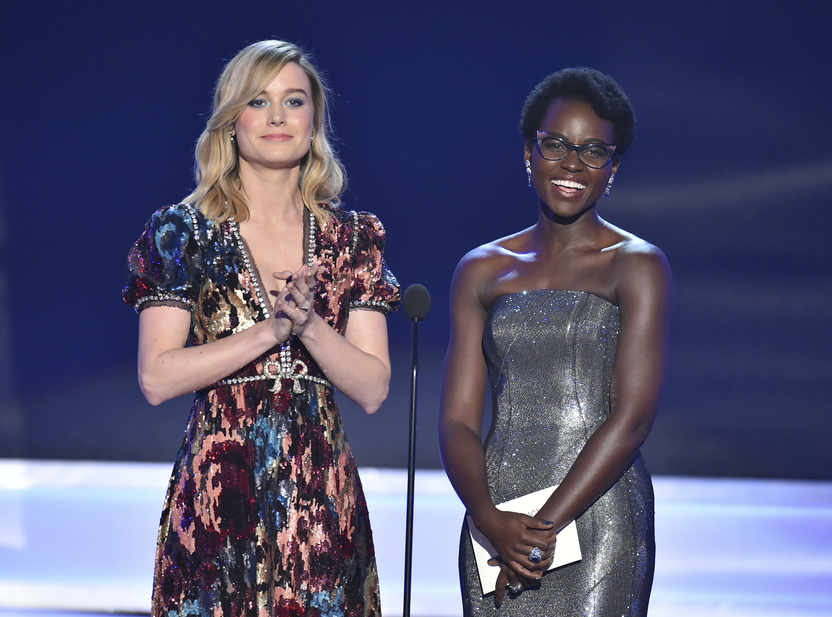 Brie Larson, left, and Lupita Nyong'o present the award for outstanding performance by a cast in a motion picture at the 24th annual Screen Actors Guild Awards at the Shrine Auditorium Expo Hall on Sunday, Jan. 21, 2018