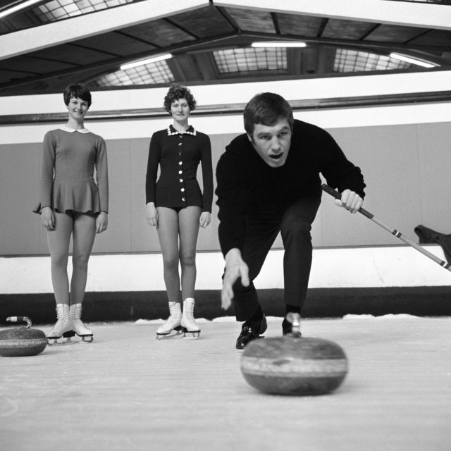 Boxer Billy Walker training for a fight with Ray Patterson in 1955 by testing his hand at curling (PA)
