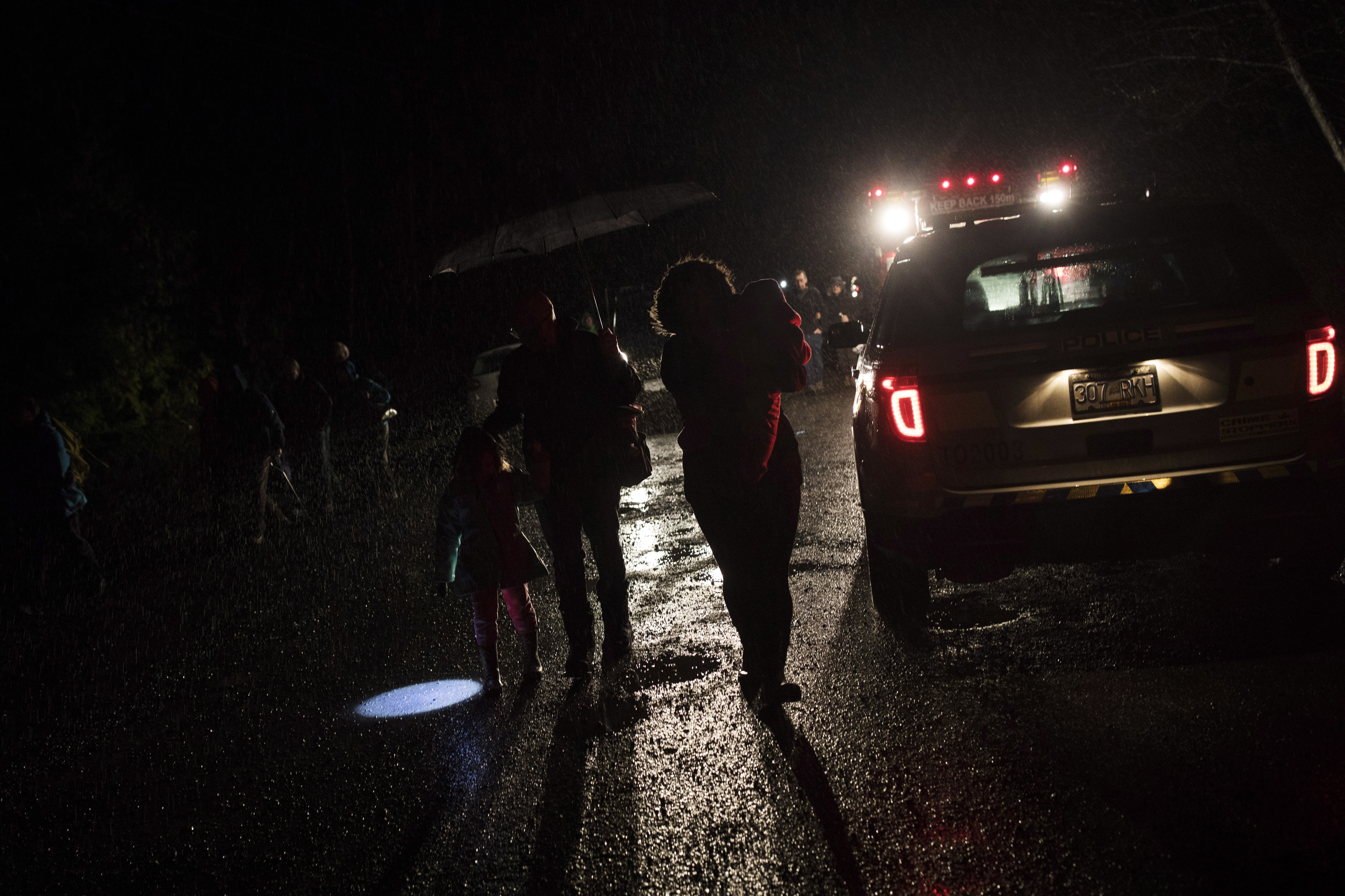 Tofino residents and visitors leave the community center after the tsunami warning ends, in Tofino, British Columbia