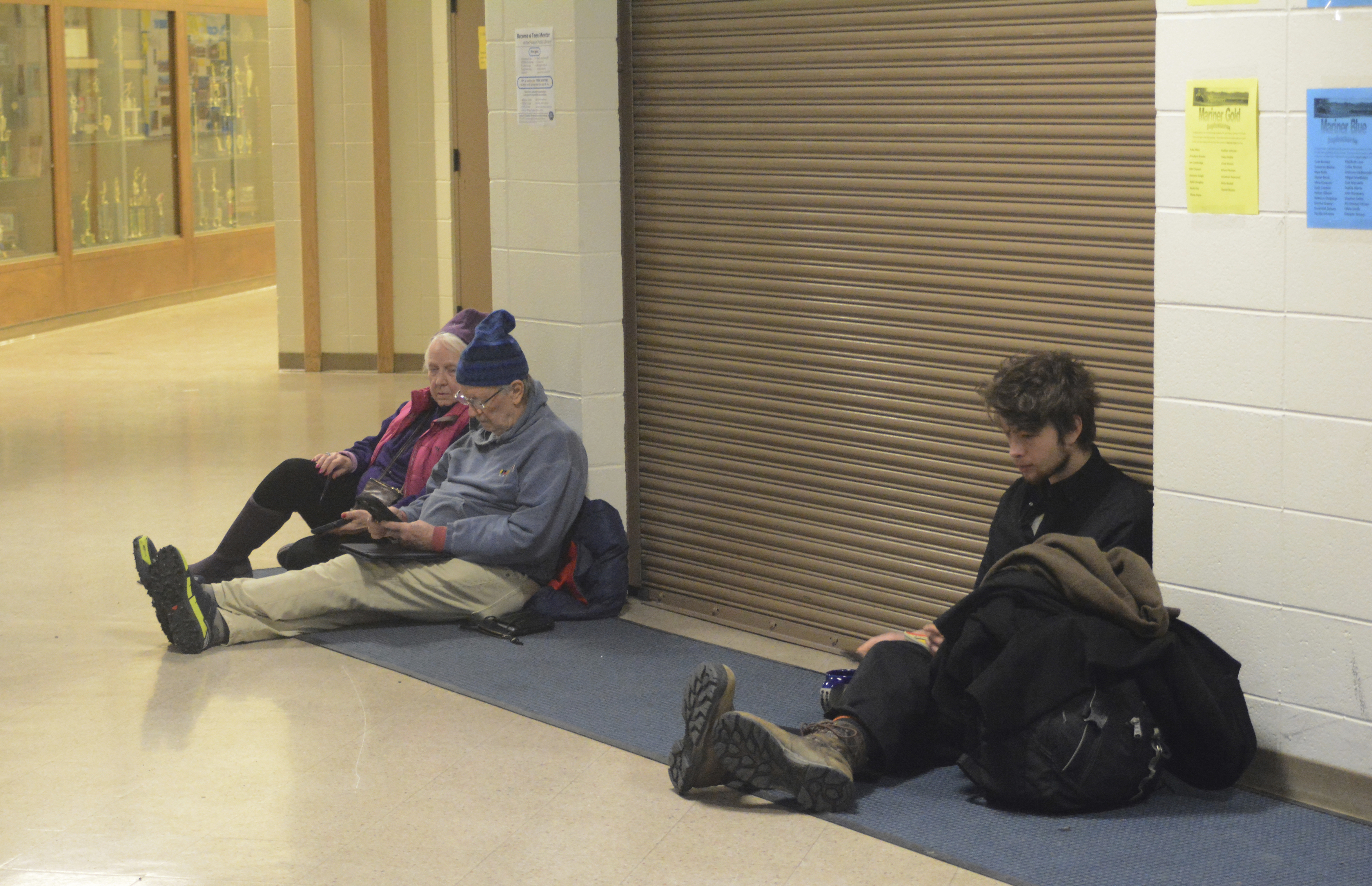 People wait for the all-clear at Homer High School during a tsunami alert for Homer, Alaska