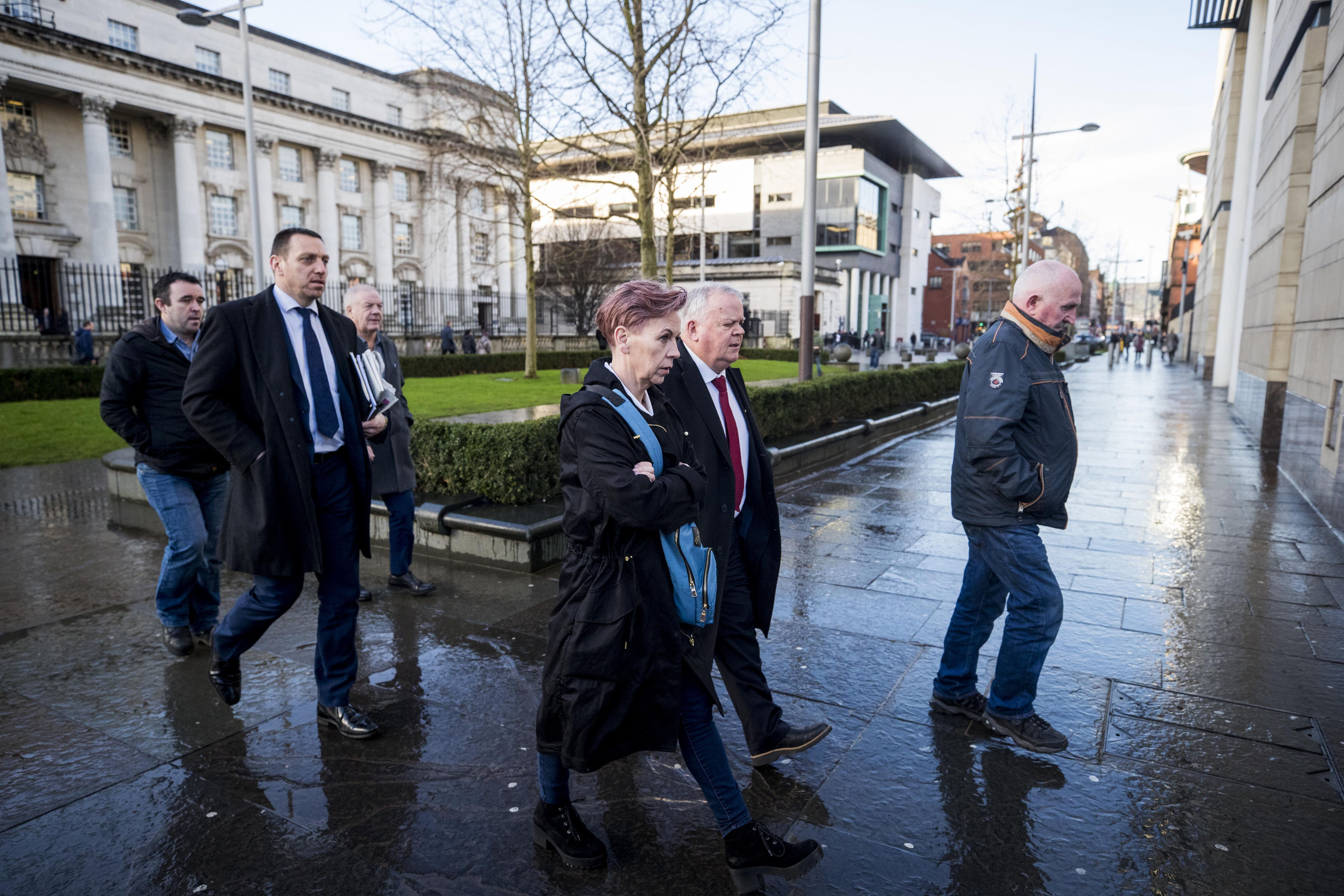 Keiran Fox (son of Eamon Fox, left), solicitor Padraig O'Muirigh (2nd left) Raymond McCord Snr (father of Raymond McCord Jnr 3rd left), SDLP MLA John Dallat (2nd right) and Joe Convie (father of Gary Convie, right) arriving at Laganside courts in Belfas