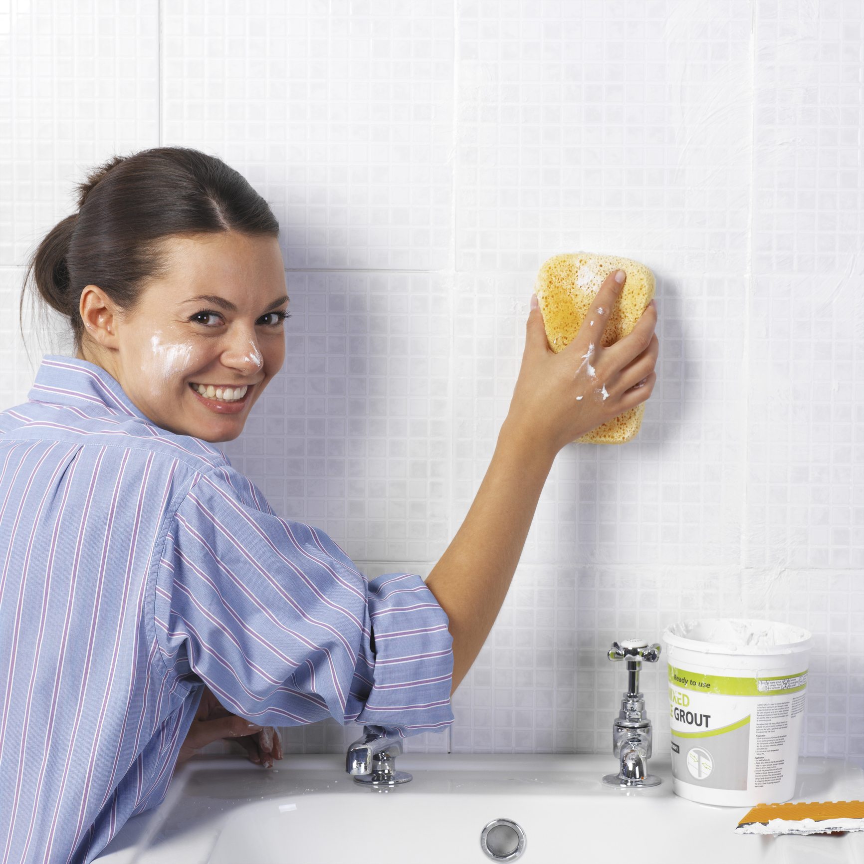 Woman scrubbing bathroom wall (Thinkstock/PA)