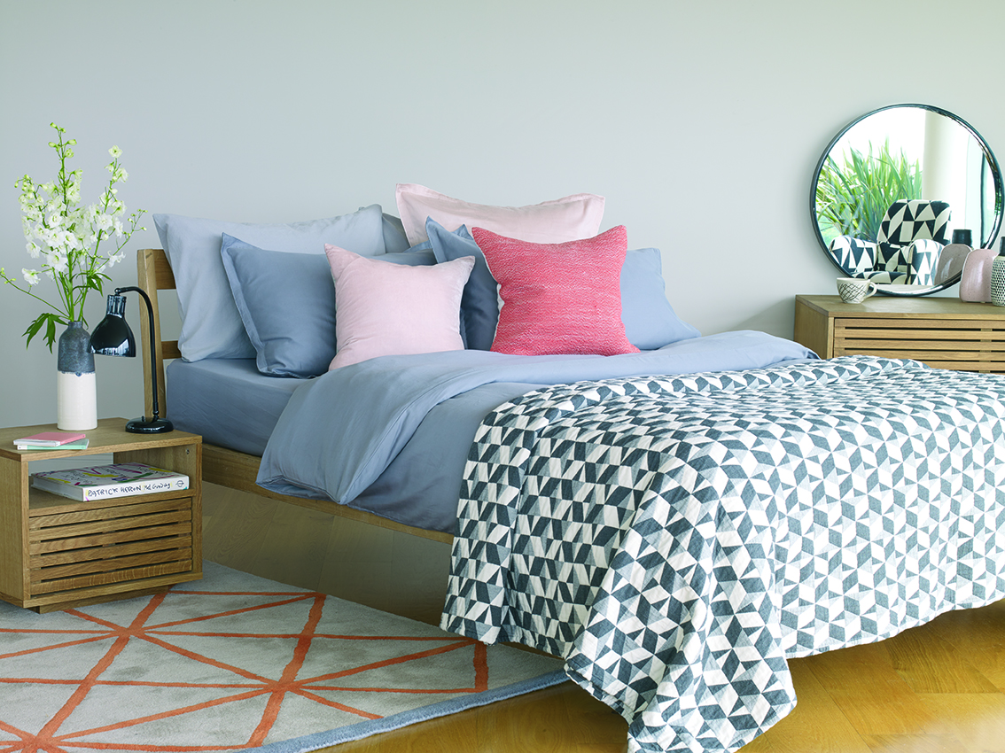 Tatsuma Double Bed Frame £375; Max Oiled Oak Bedside Table with Shelf, £180; Grid Rug, £350; Washed Grey Sateen Double Duvet Cover Set, £90; Paulista Quilted Bedspread, £150; Nixon Cushion, £25, Habitat (Habitat/PA)