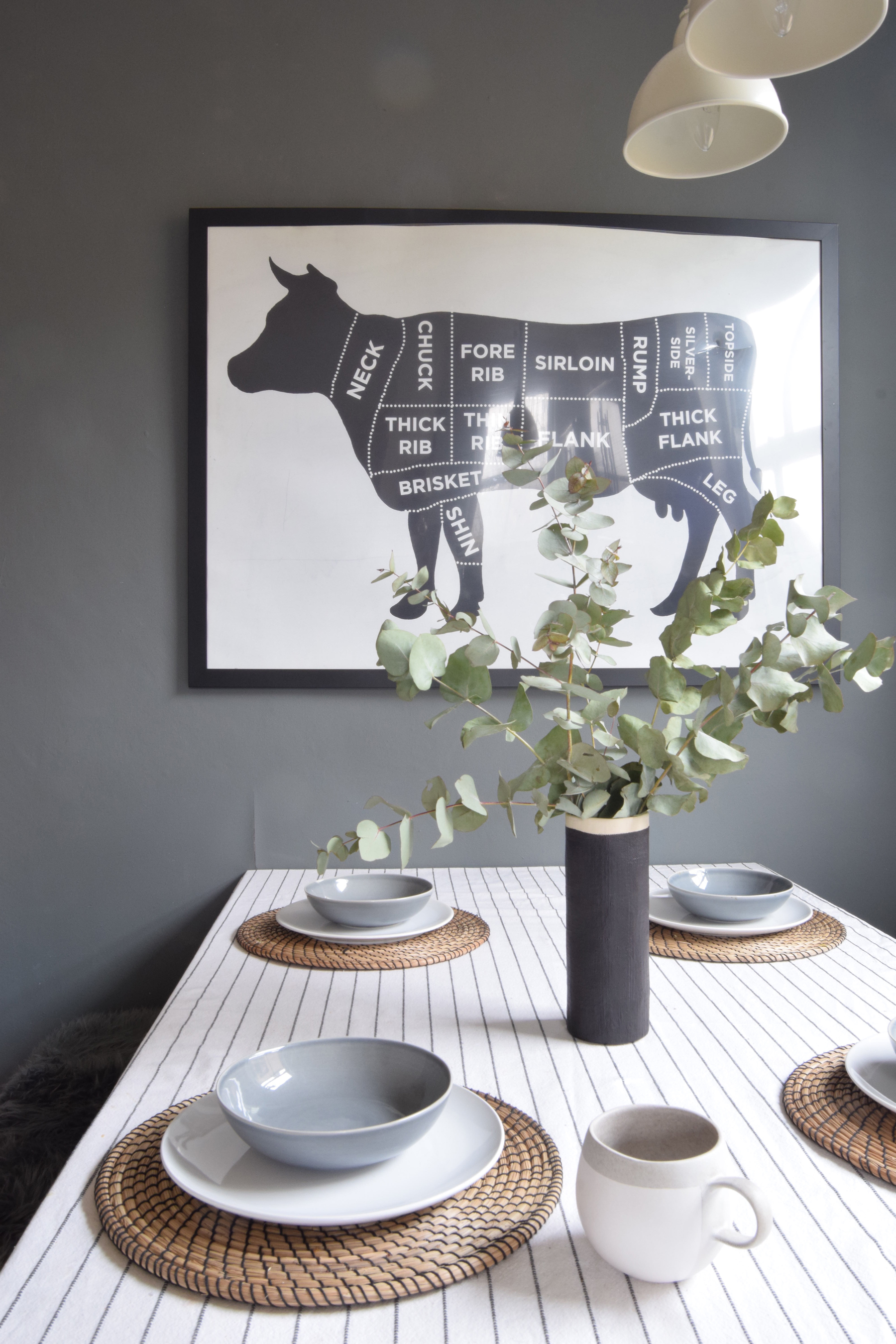 A dark grey feature wall makes a perfect contrast with a white tablecloth and china (Topology/PA)