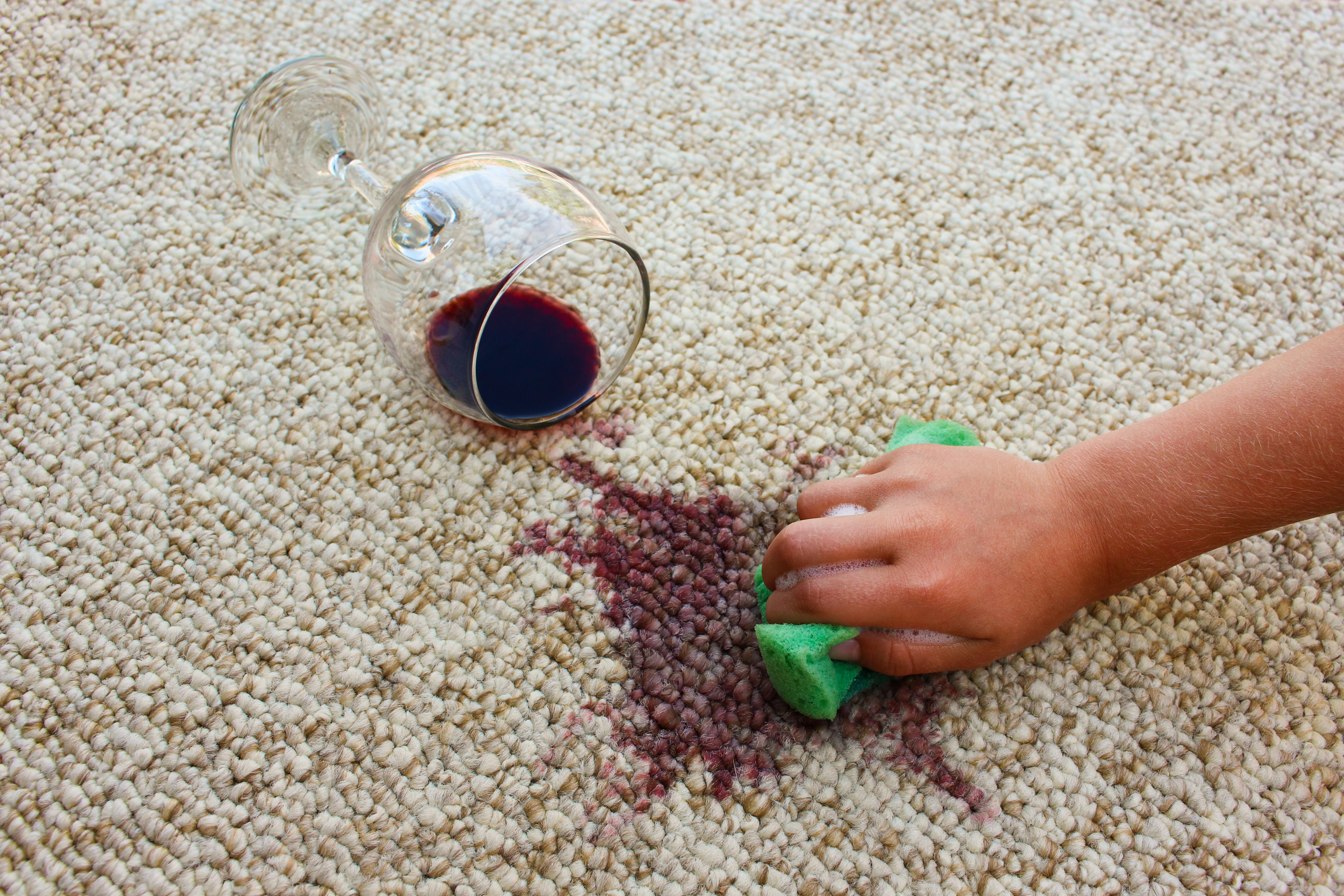Red wine spillage on carpet