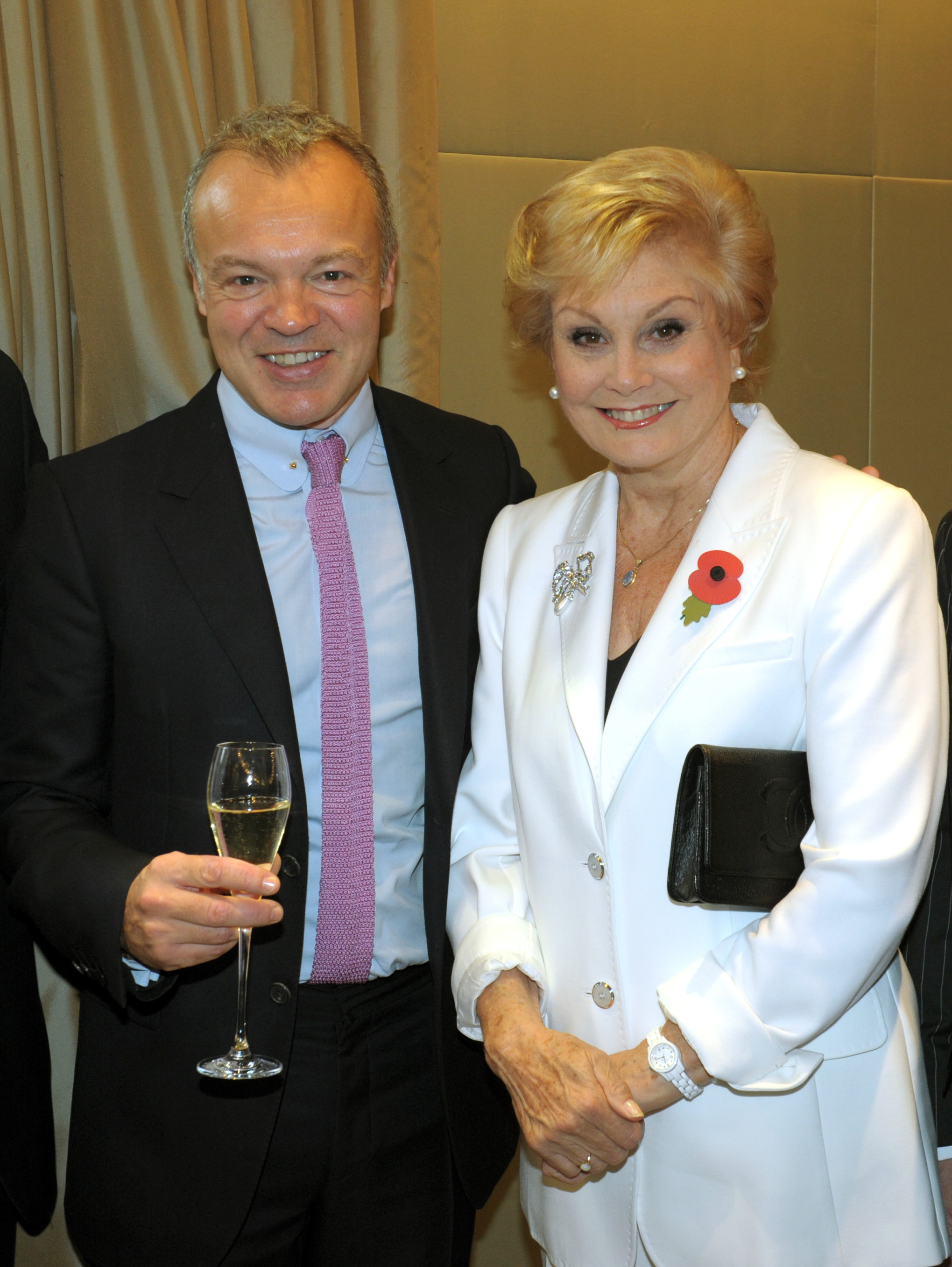 Graham Norton with Angela Rippon in 2013 (Anthony Devlin/PA)