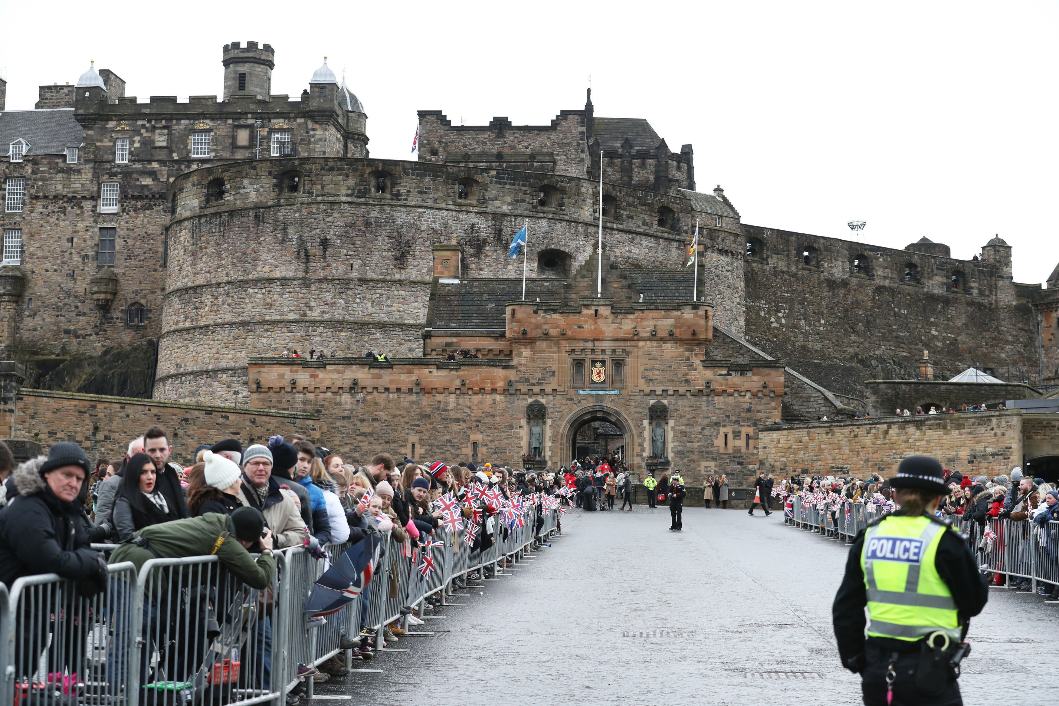 Crowds gather ahead of a visit by Prince Harry and Meghan Markle to Edinburgh Castle (Andrew Milligan/PA)