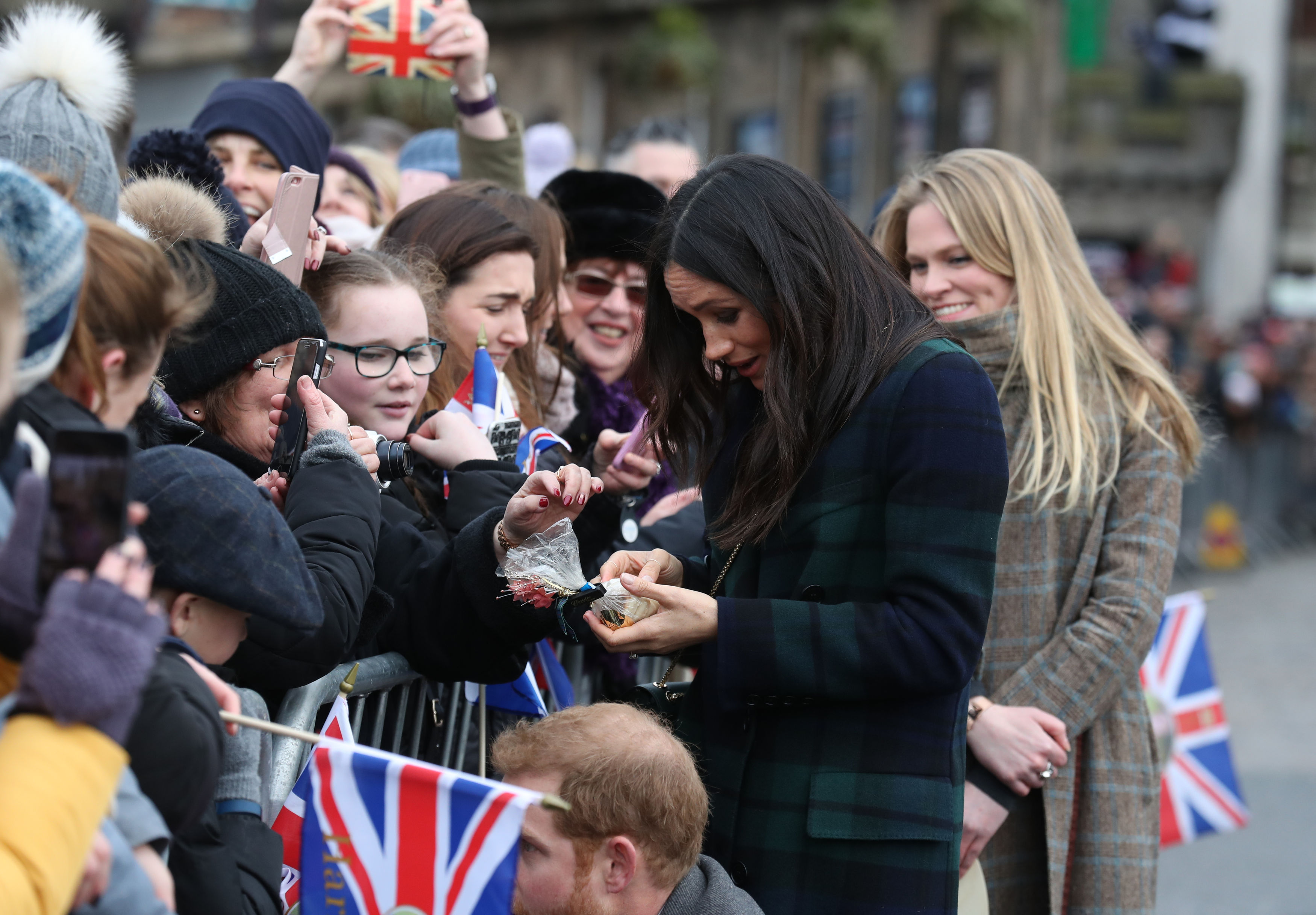 Meghan Markle in a tartan coat during a walkabout (Andrew Milligan/PA)