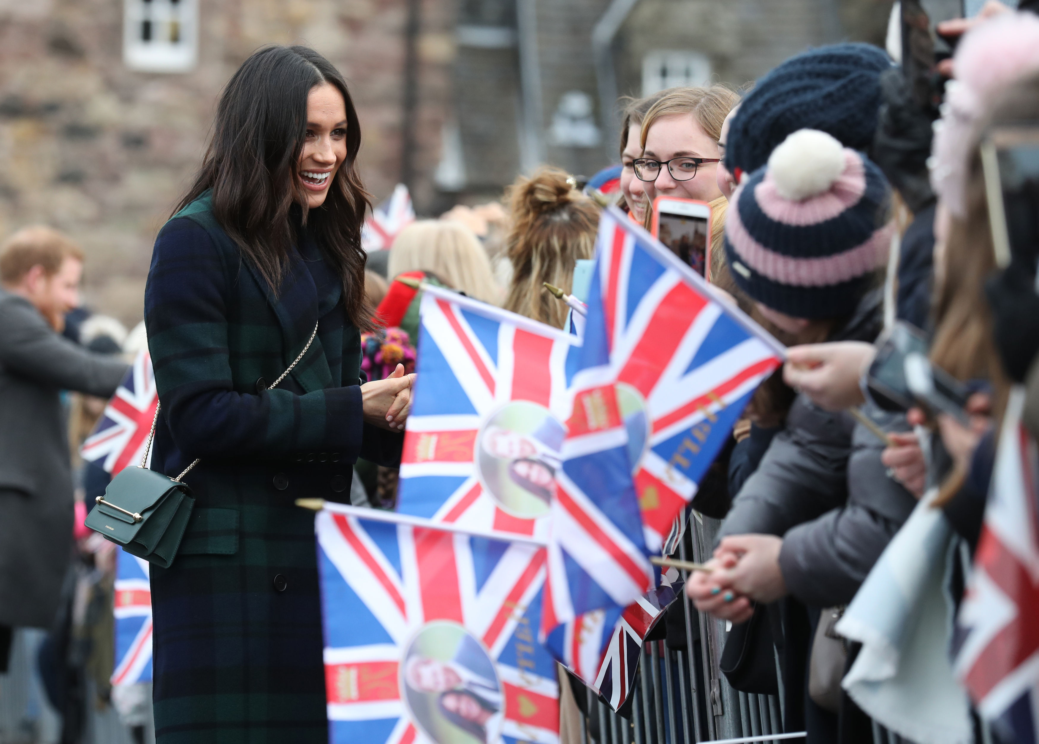 Flags were out for Meghan Markle during her walkabout (Andrew Milligan/PA)