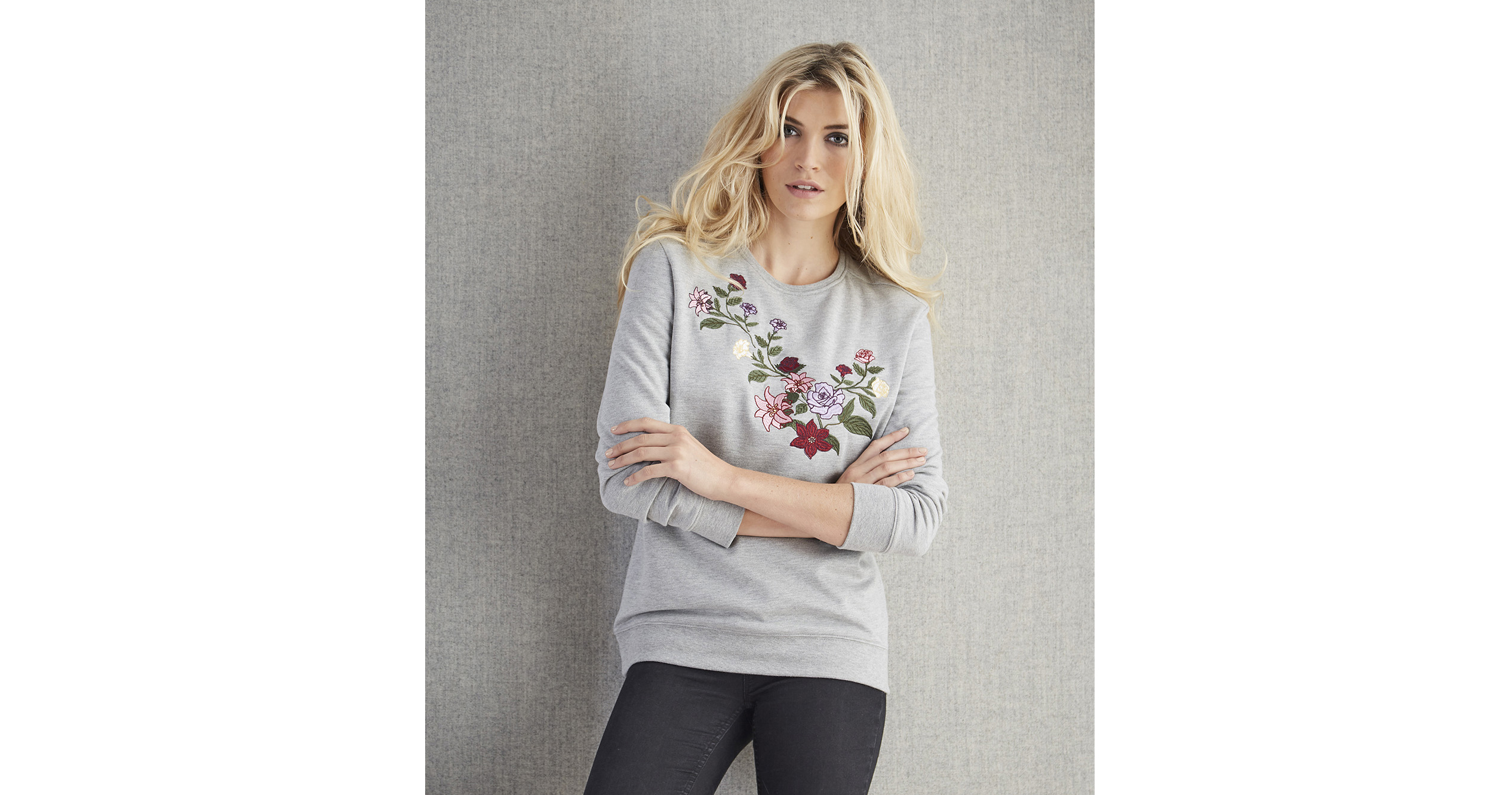 model wearing Cotton Edits Embroidered Sweatshirt and Jeans