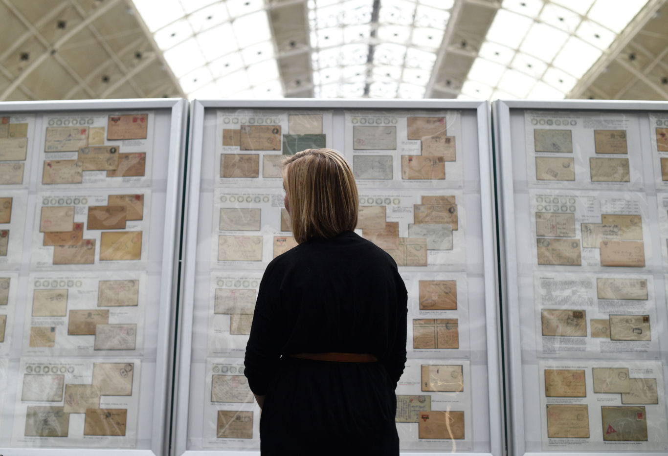 A visitor looks at a collection of envelopes and stamps during the Stampex philatelic exhibition (Kirsty O'Connor/PA)