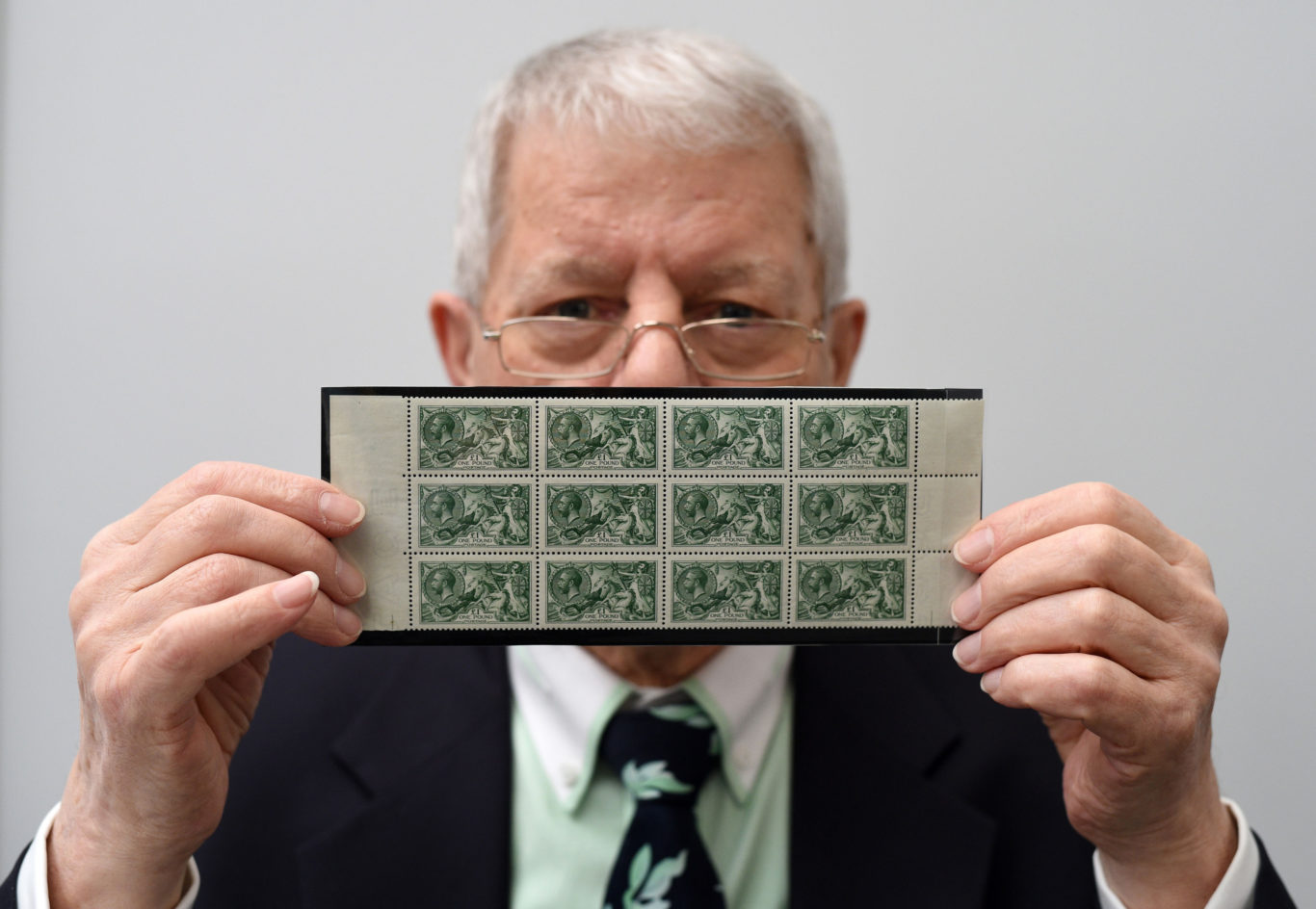 collection of twelve SG 403 £1 green stamps, 1913 Waterlow Printing seahorse issue, worth £125,000 (Kirsty O'Connor/PA)