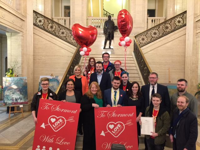 SDLP leader Colum Eastwood receives a giant Valentine's Day card