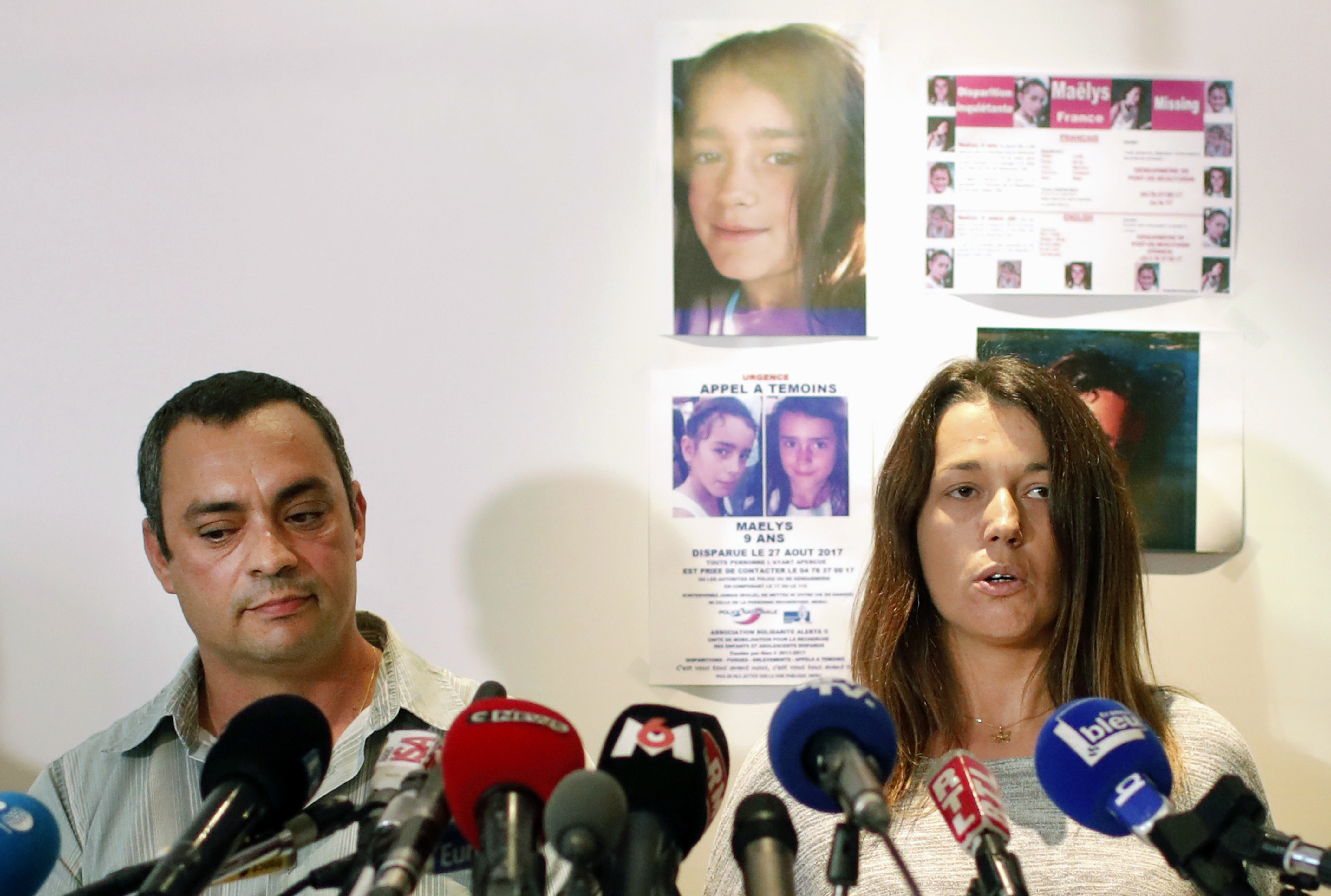 The father of Maelys, Joachim de Araujo, left, and his wife Jennifer at a press conference in Lyon after her disappearance (Laurent Cipriani/AP)