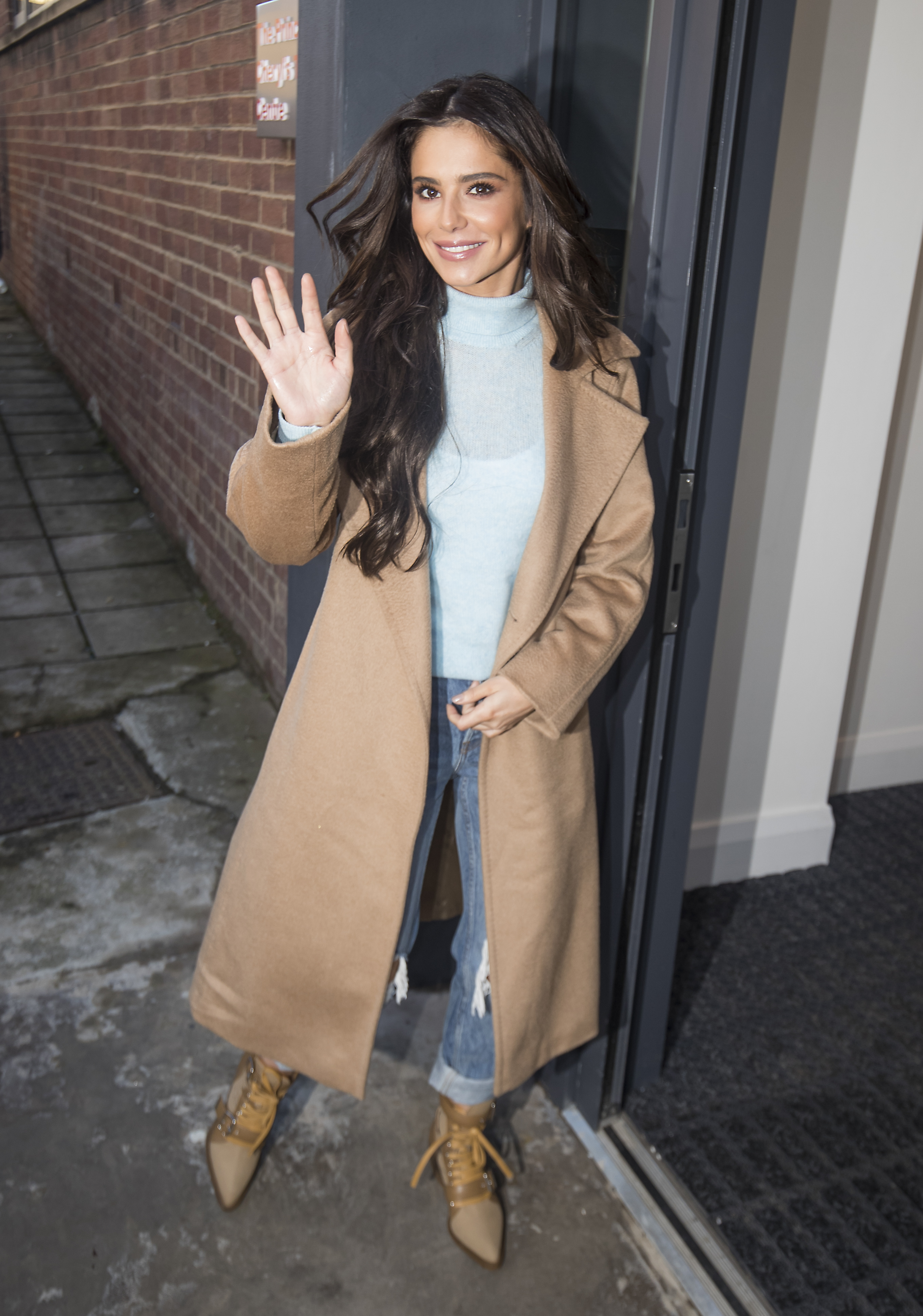 Cheryl arriving ahead of the opening (Danny Lawson/PA)