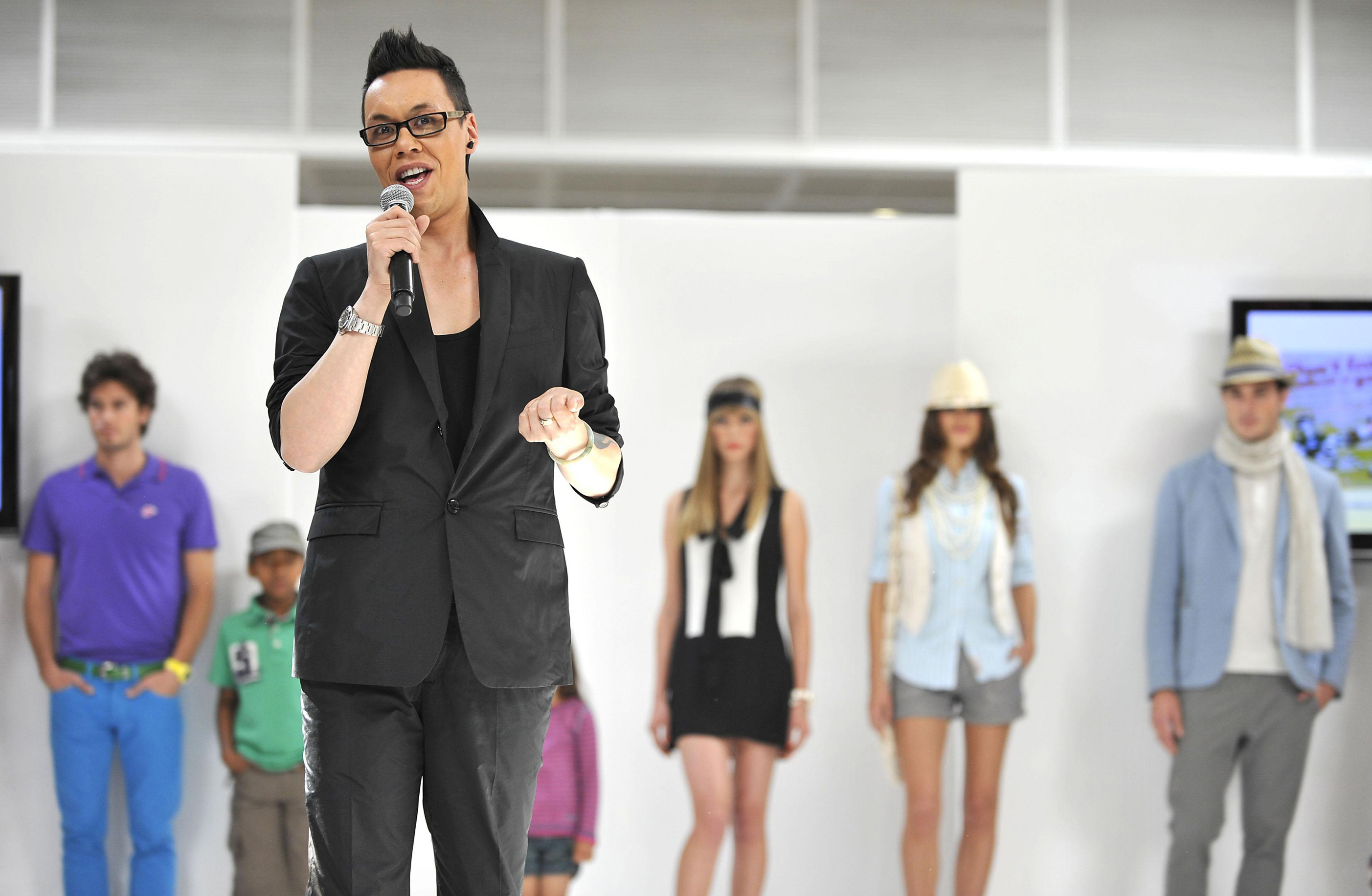 Gok Wan commentating on the catwalk at a fashion show (PA)