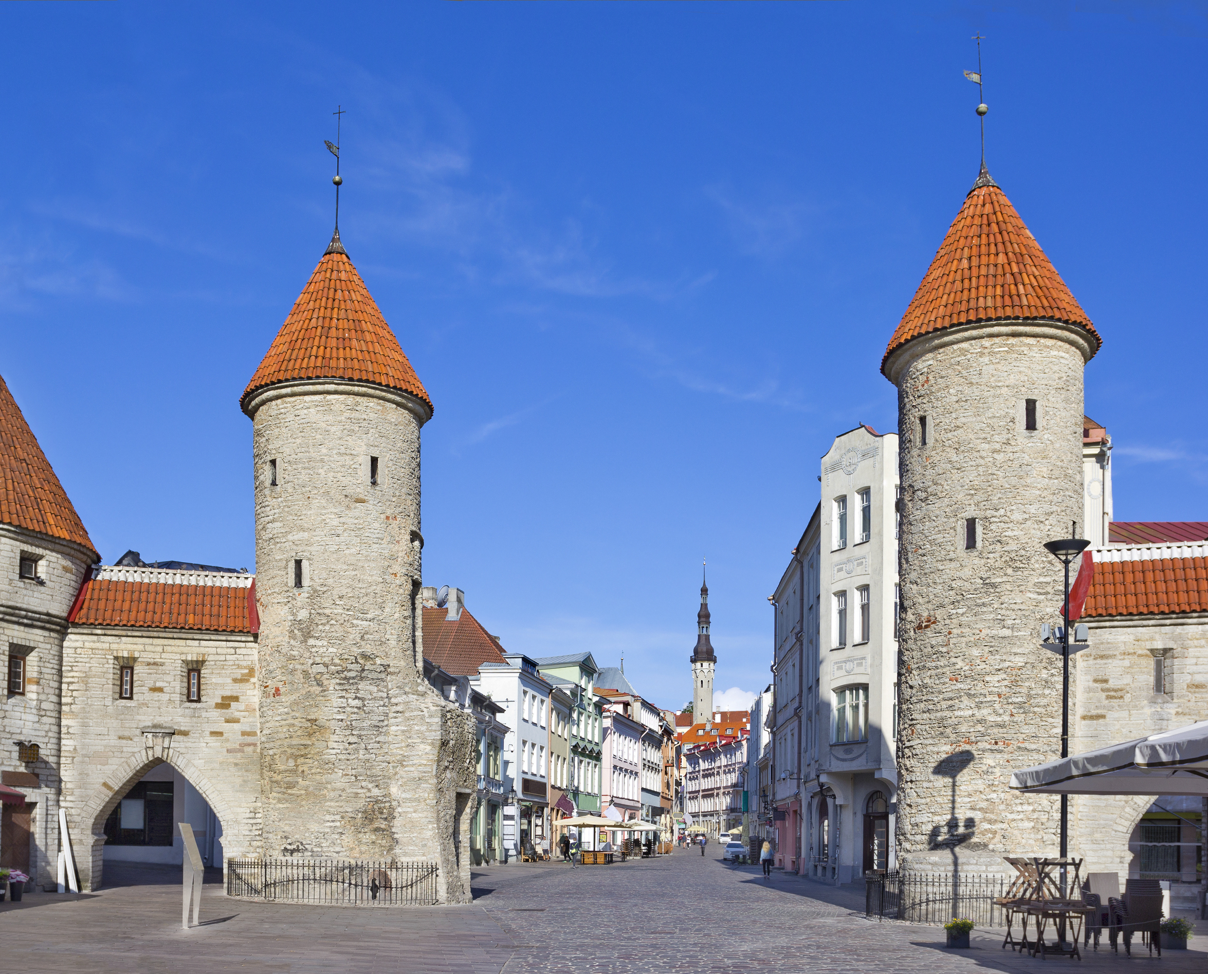 View of old Tallinn through medieval Viru gate with towers, Estonia