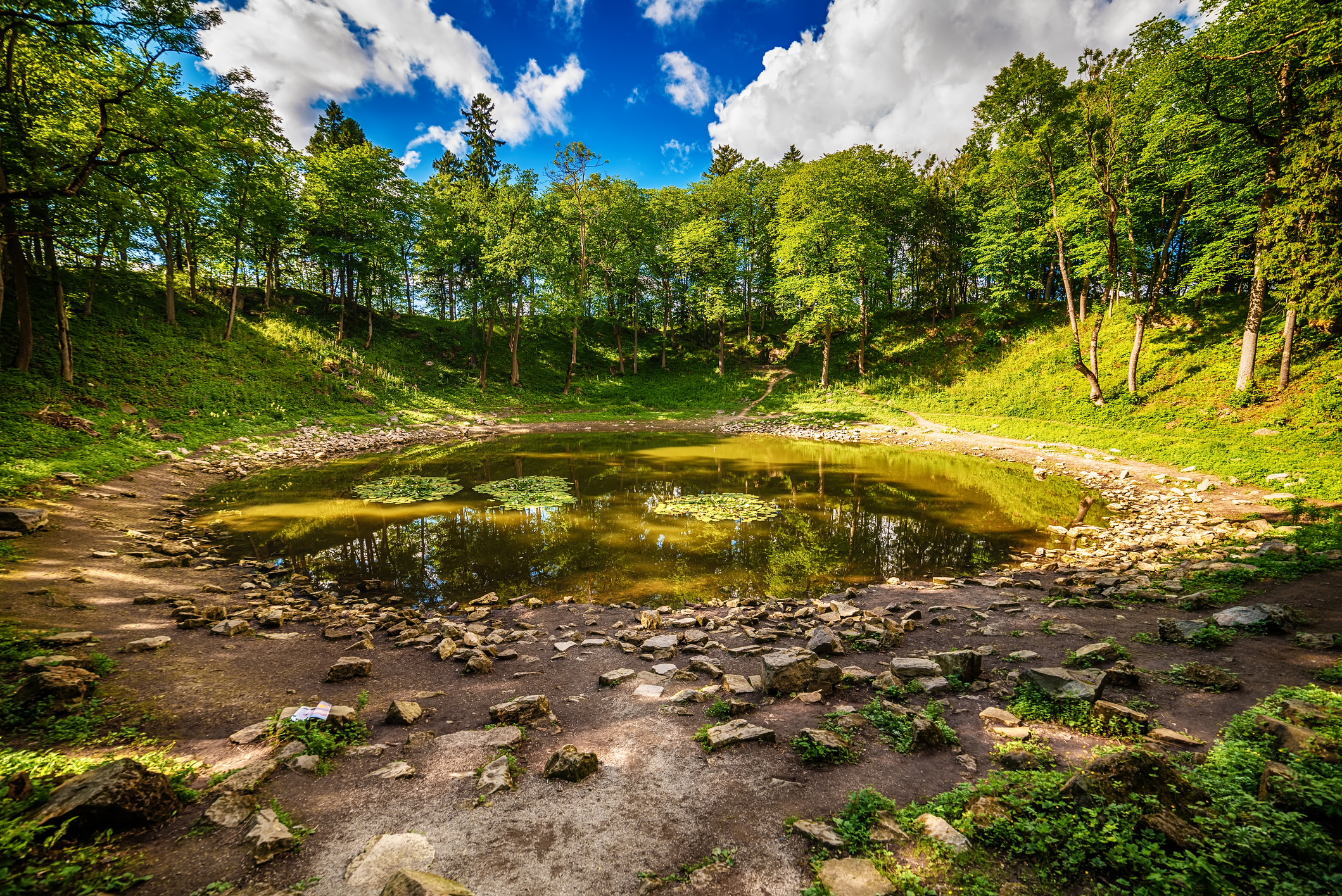 Saarema Island, Estonia: the main meteorite crater in the village of Kaali in the summer
