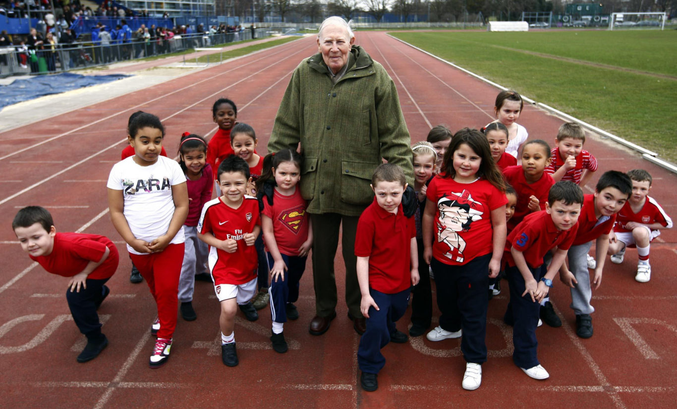 Sir Roger with children from Our Lady's school in Poplar, who were taking part in a charity running day in aid of Sport Relief (PA)