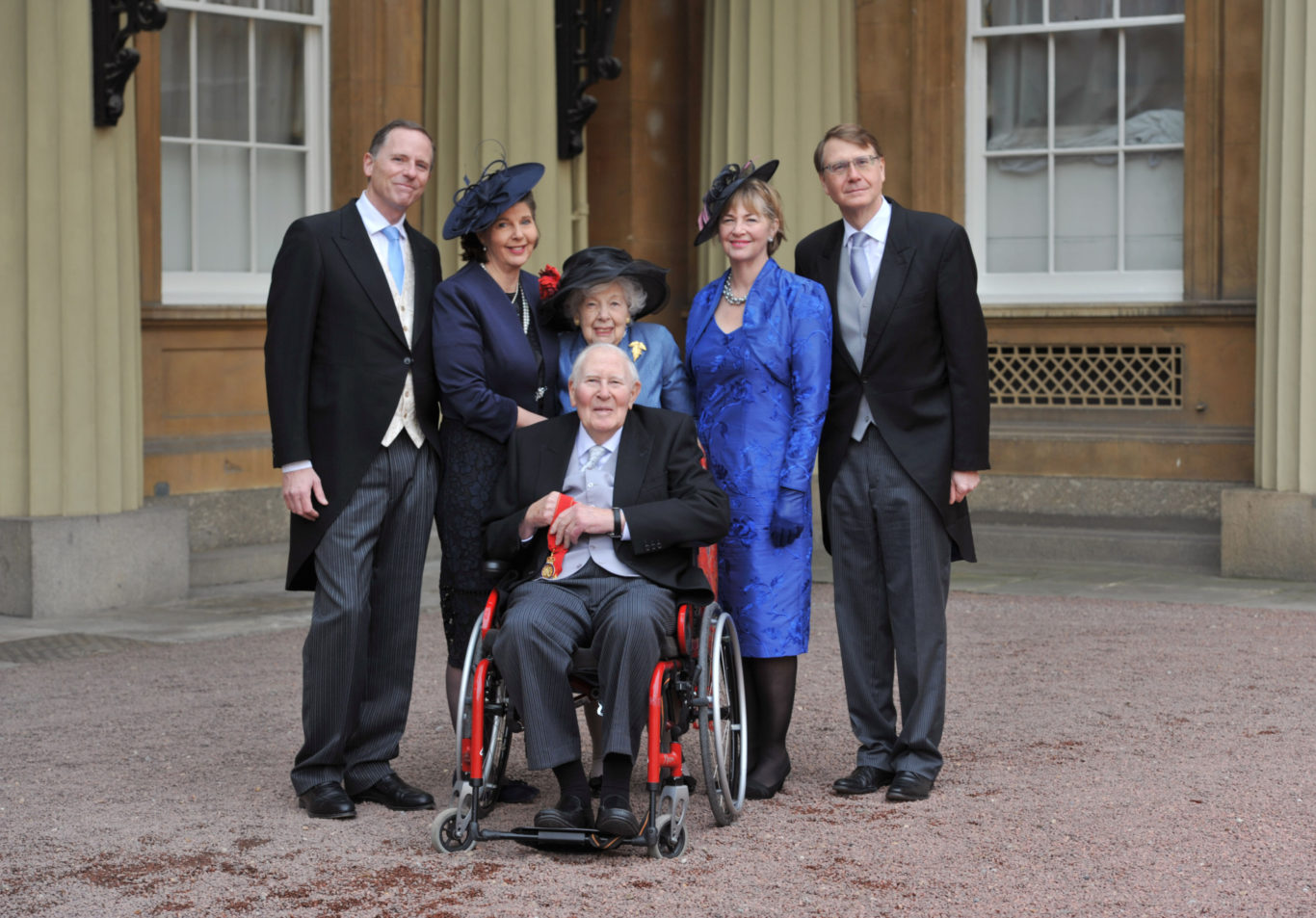 Outside Buckingham Palace with his family (PA)