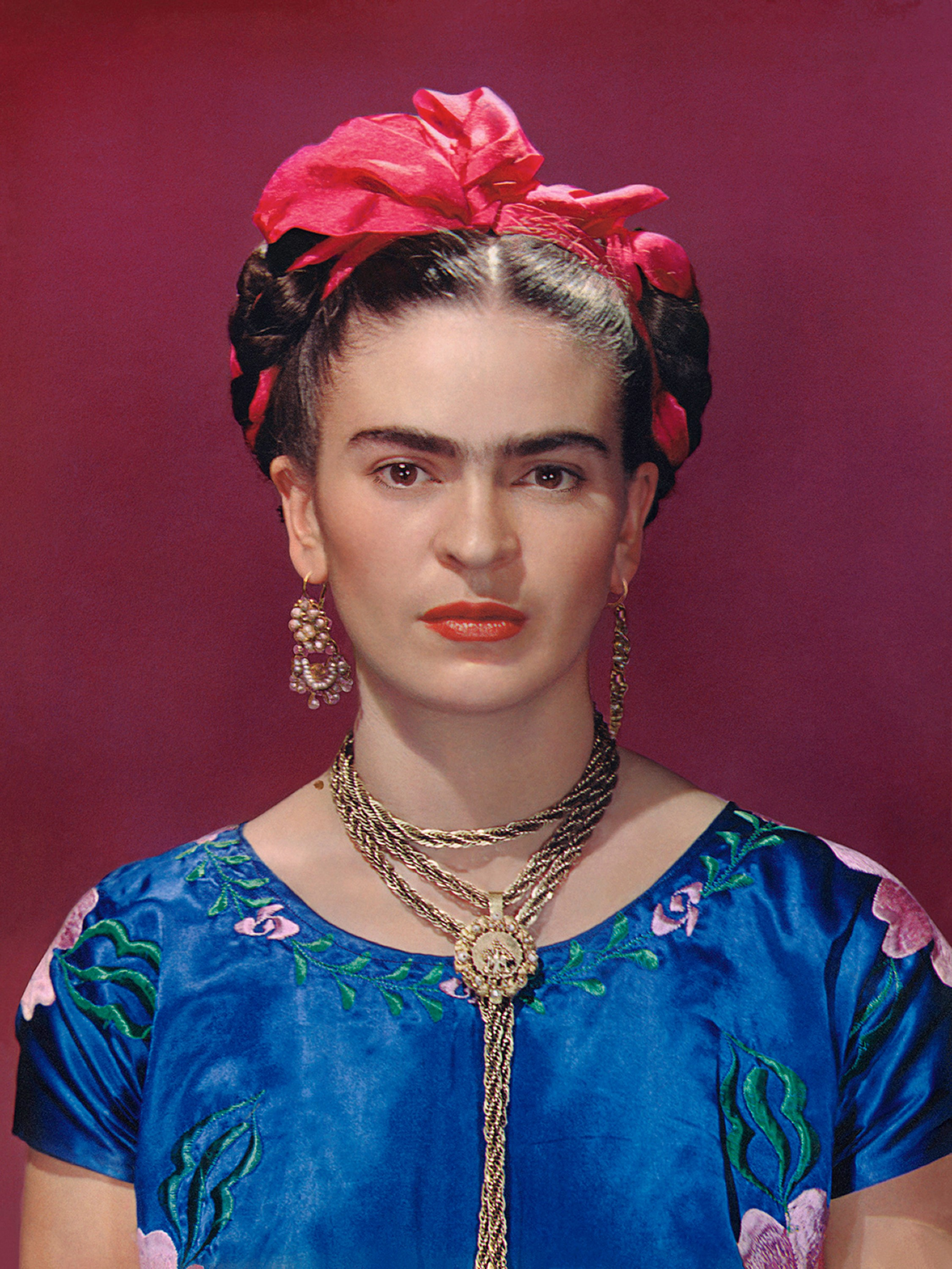 Frida Kahlo in blue satin blouse, 1939, photograph by Nickolas Muray (Nickolas Muray Photo Archives)