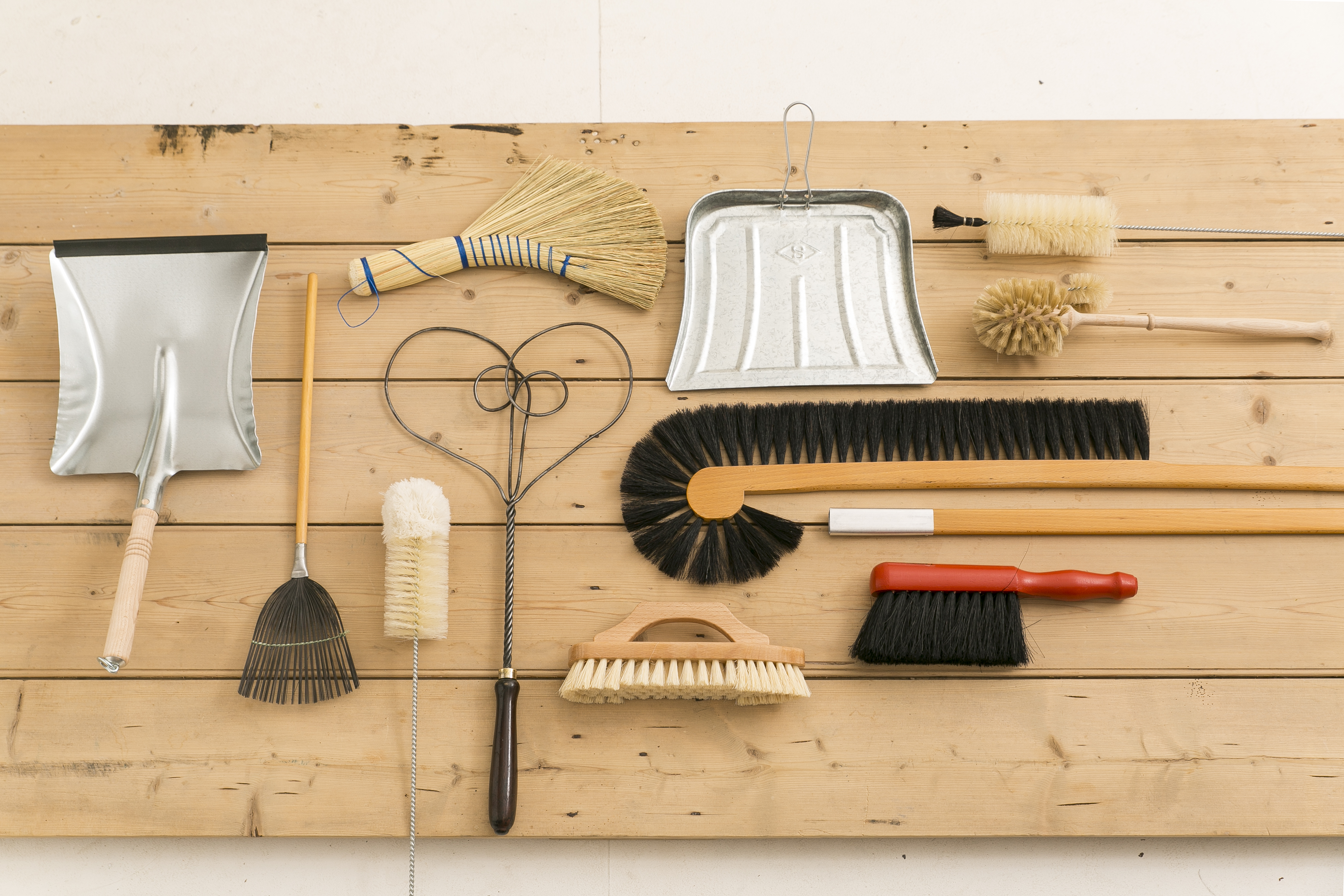 (l-r) Dustpan, £9; Fly Swat, £9; Bottle Brush, £6.75; Rice Straw Hand Brush, £7.50; (heart shaped) Old Carpet Beater, £14.50; Dustpa ?; Extending Cupboard Brush, £35; Red Handled Brush, £6.50; Bottle Brush, £7; Loo Brush with Rim Cleaner, £8, RE for the Home (RE for the home/PA)