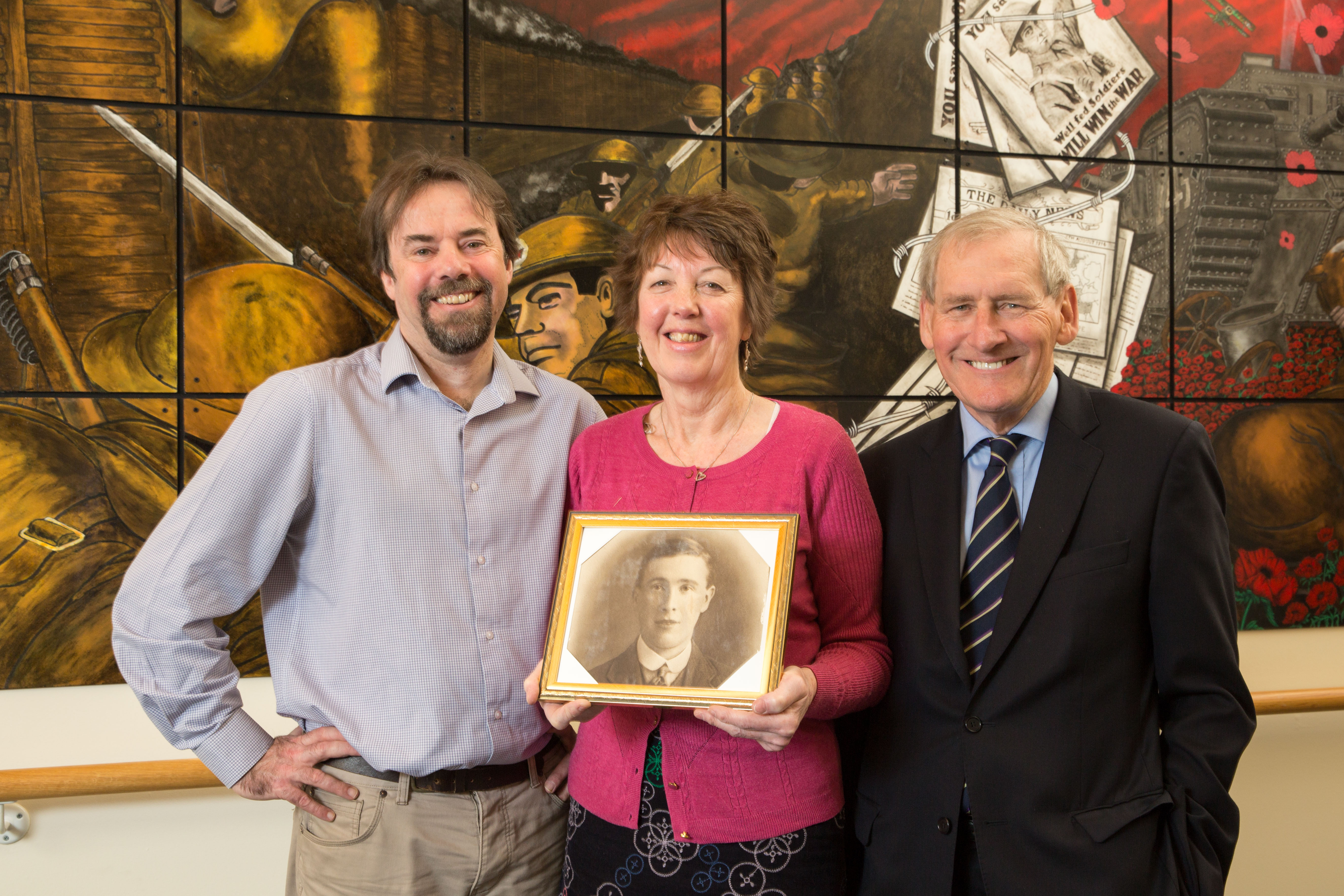 Moira Gallie (centre) holding a photo of her grandfather James Henderson with Professor Tony Pollard from Glasgow University (left) and Erskine chairman Robin Crawford (right) (Robert Perry/Erskine/PA)