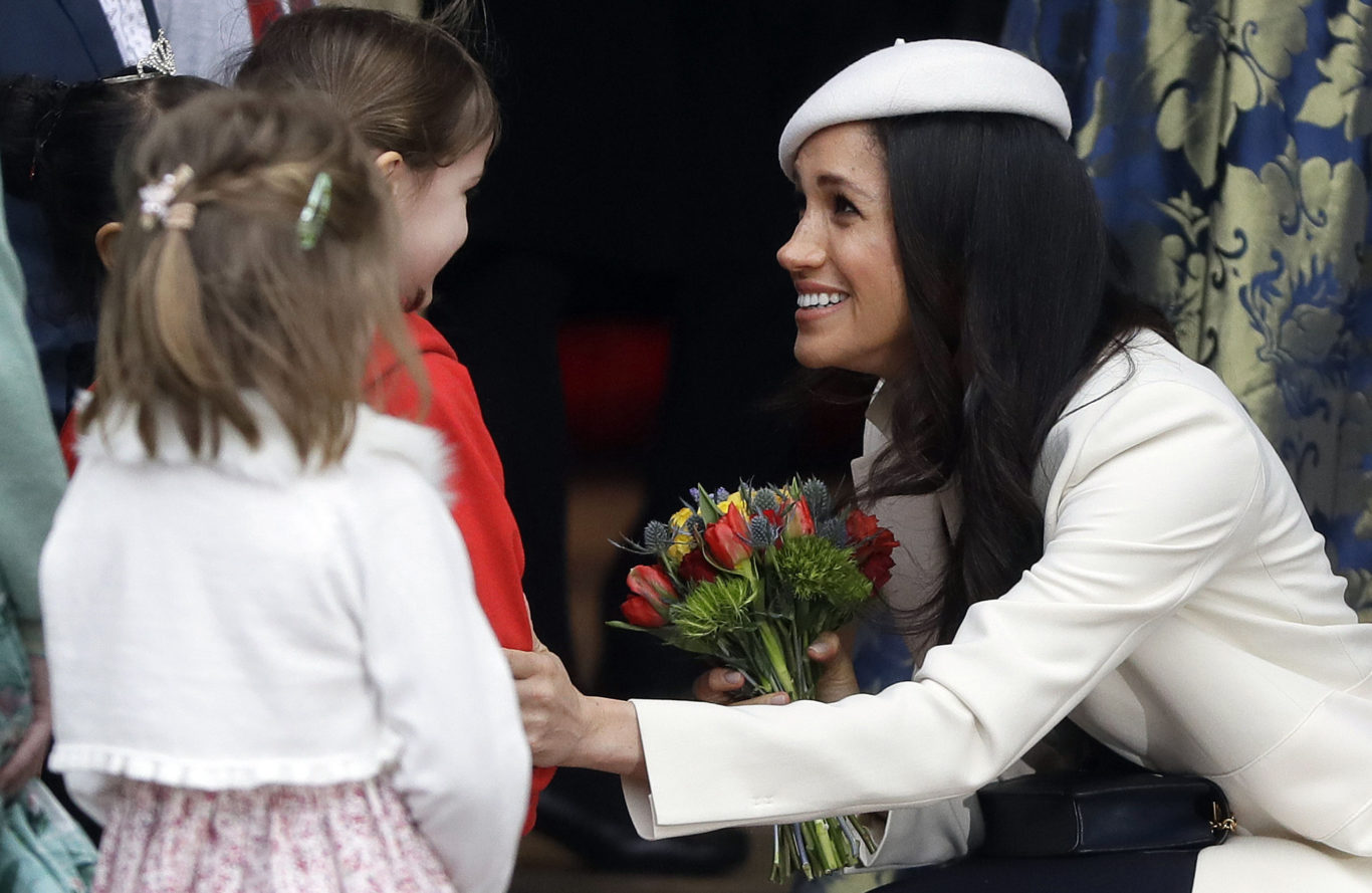 Meghan Markle receives flowers after attending the Commonwealth service (Kirsty Wigglesworth/PA)