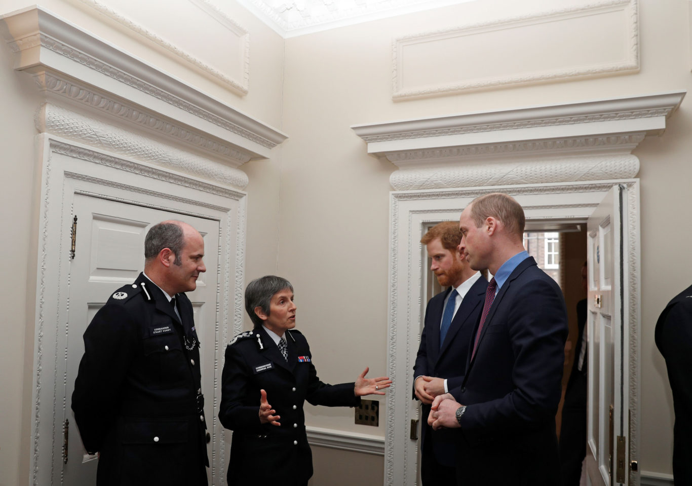 The Duke of Cambridge and Prince Harry chat to Ms Dick (Adrian Dennis/PA)