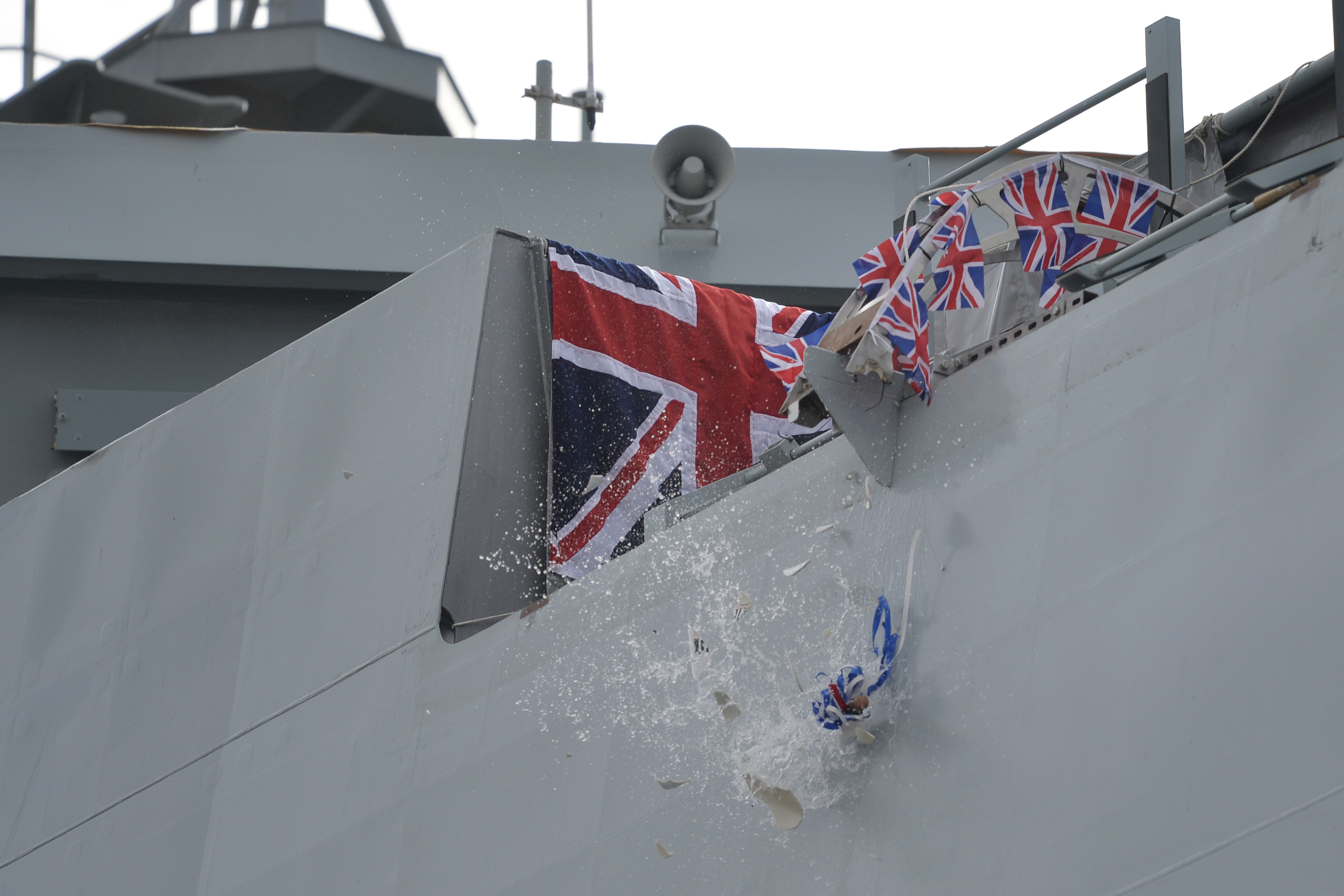 A bottle from Nelson's Gin Distillery & Gin School was smashed onto the ship during the ceremony (John Linton/PA)