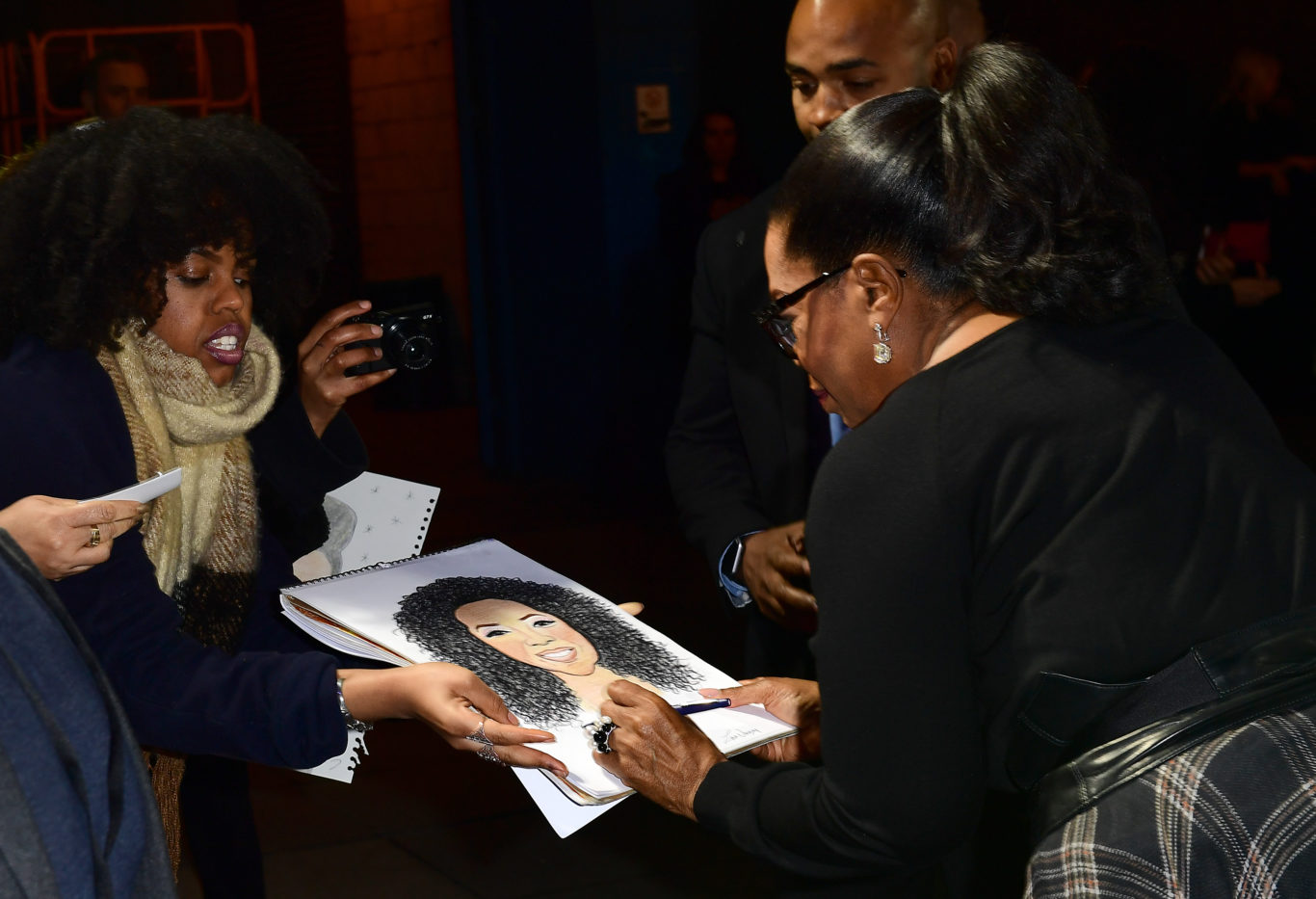 Oprah Winfrey signs autographs for fans (Ian West/PA)