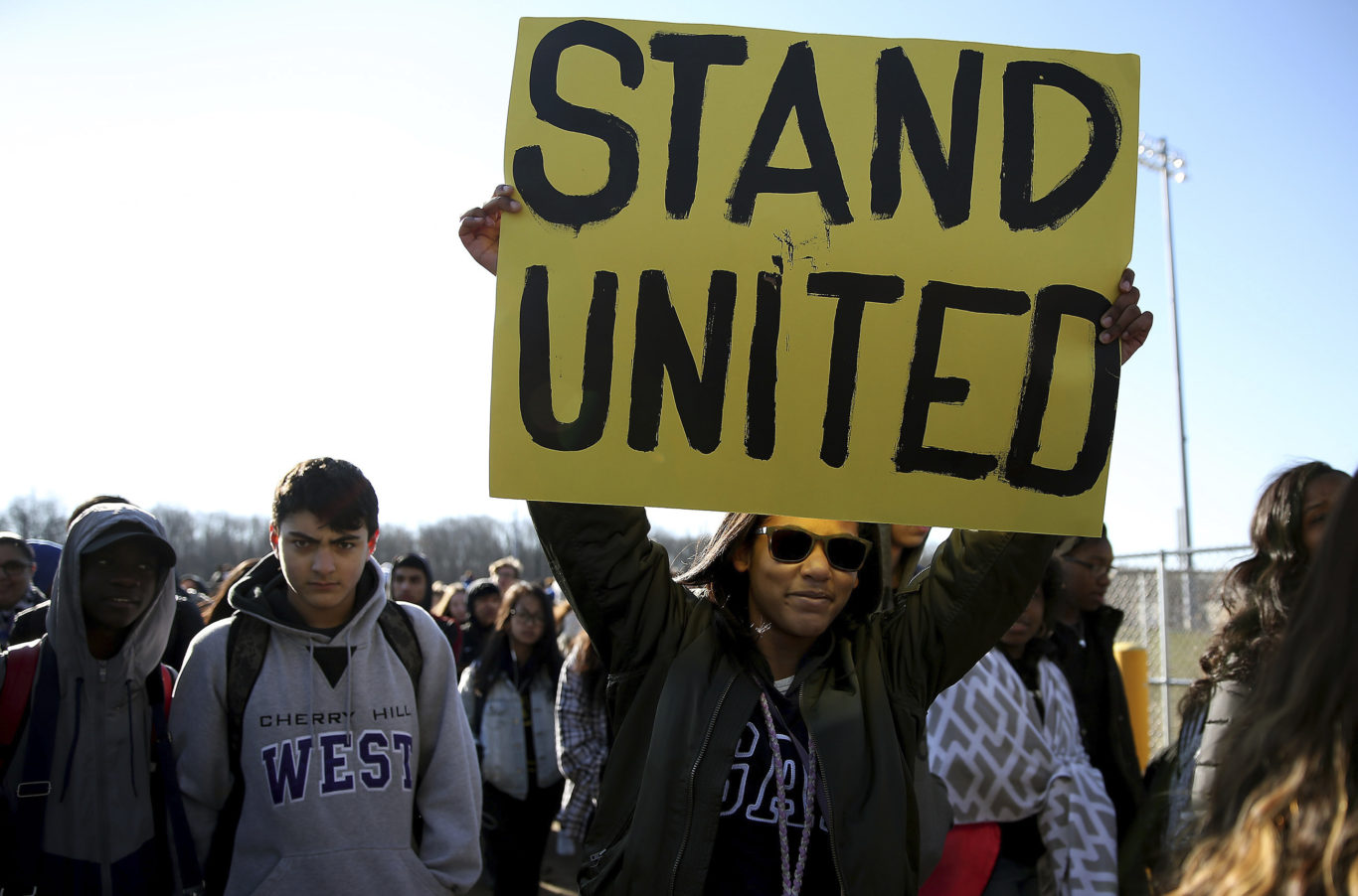 Kennedi Lawson, 14, carries a sign as student walkout at Cherry Hill West High School (David Maialetti/AP)