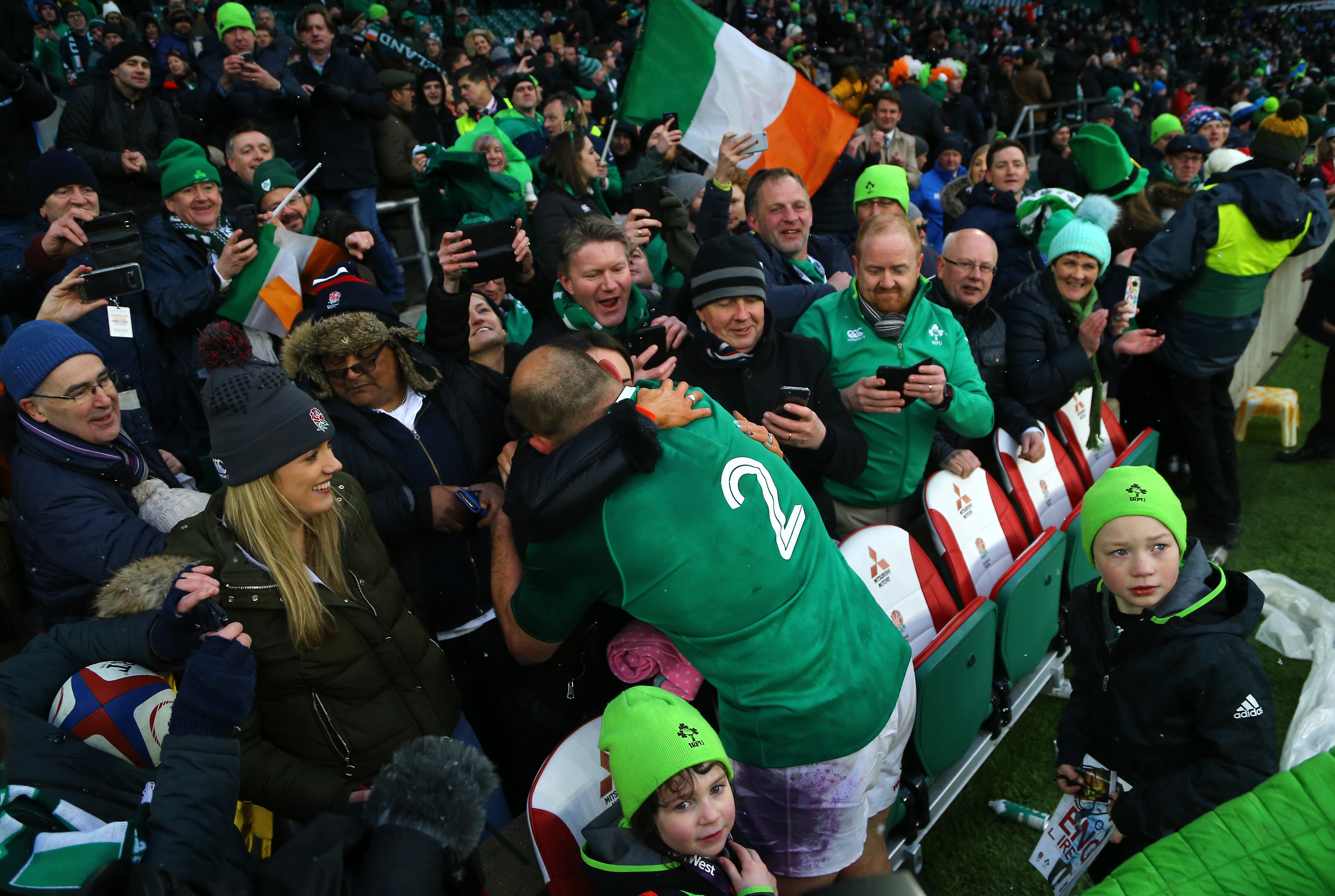 Ireland's Rory Best celebrates with family after winning the grand slam during the NatWest 6 Nations match at Twickenham Stadium, London