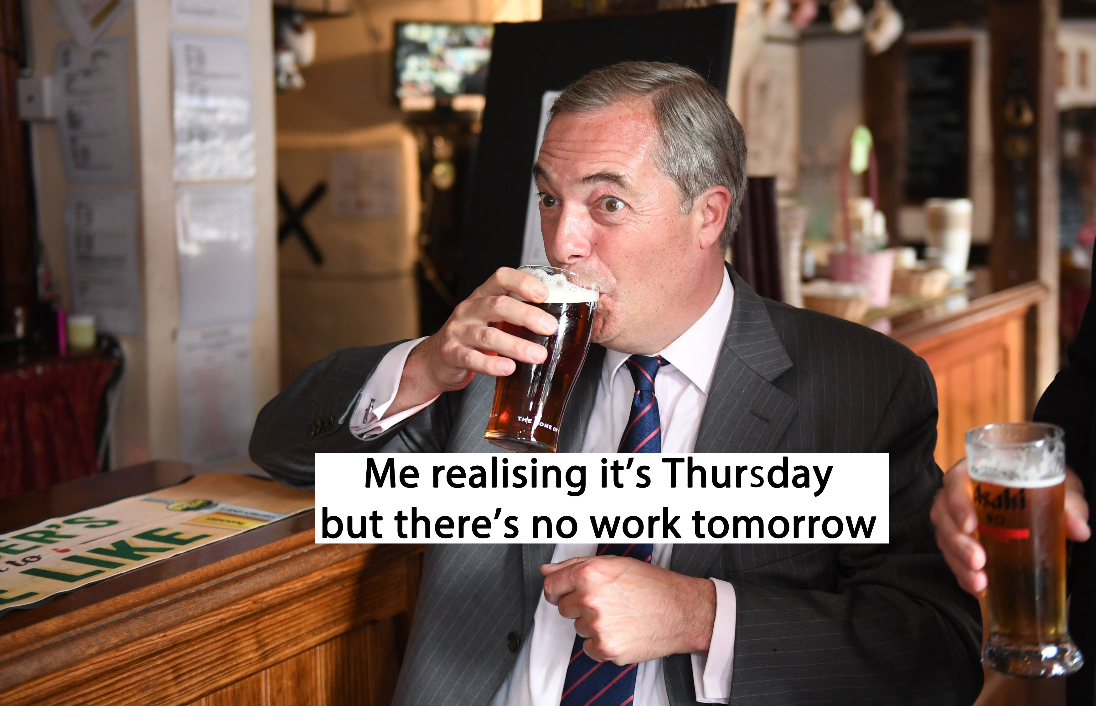 Nigel Farage drinking a pint