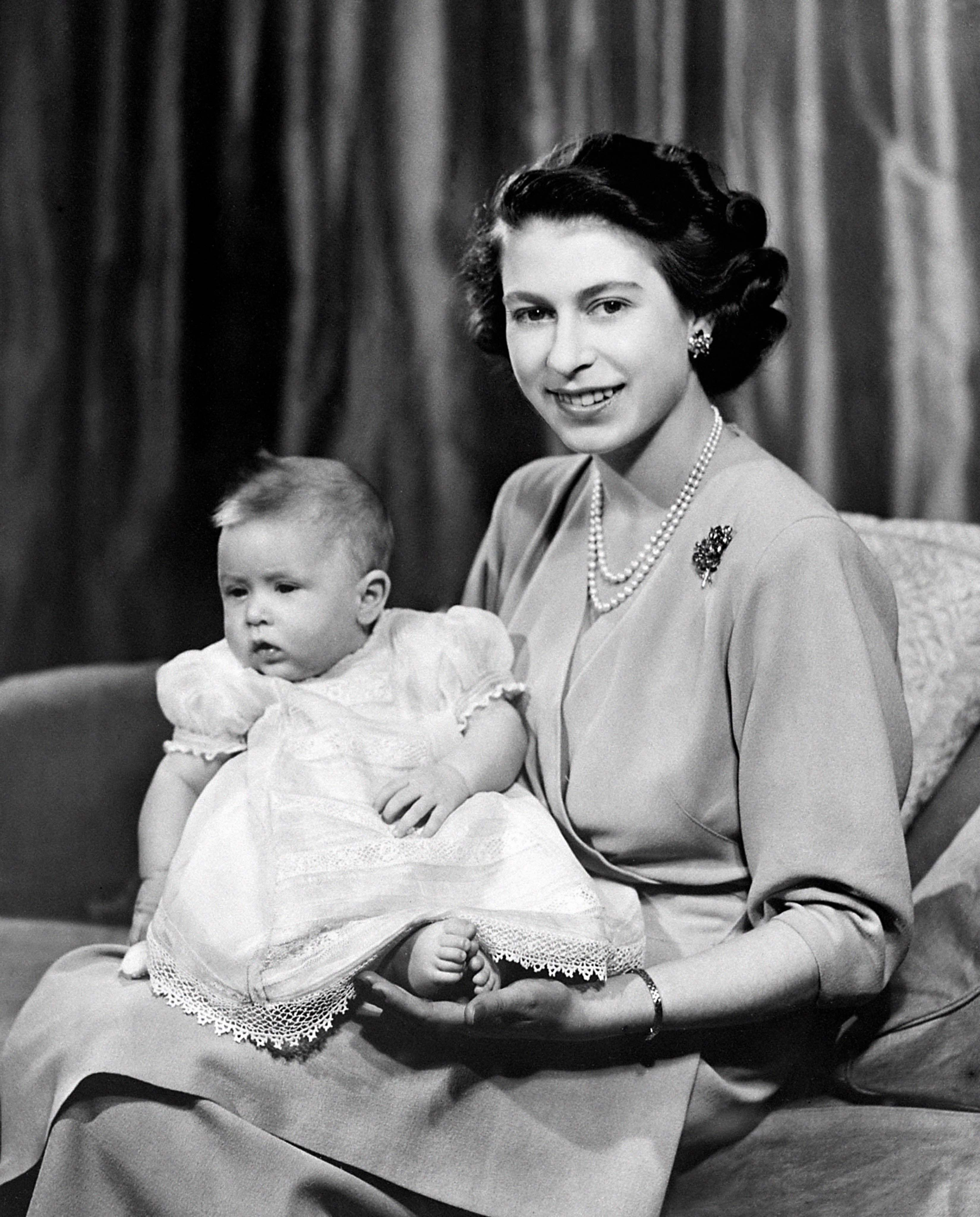 Queen Elizabeth II with baby Charles (PA)