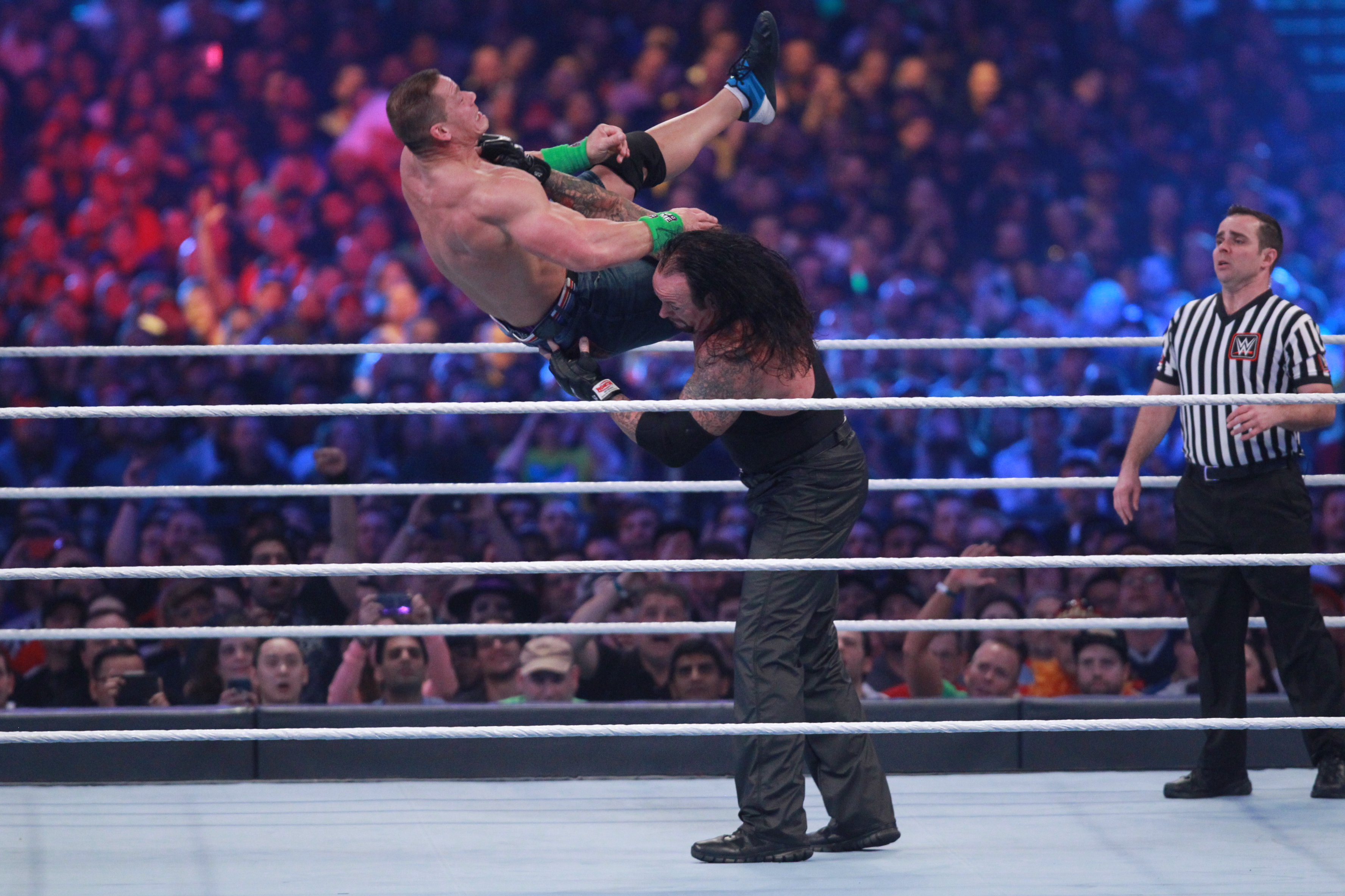 Cena being thrown by the Undertaker