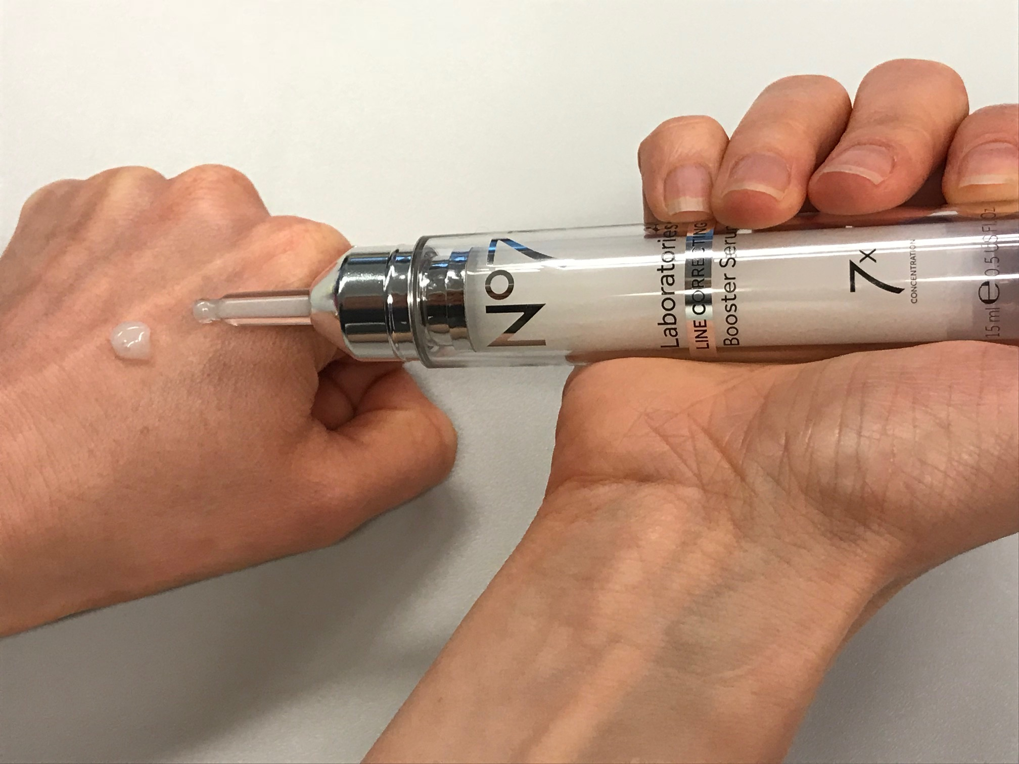 woman testing No7 Laboratories Line Correcting Booster Serum