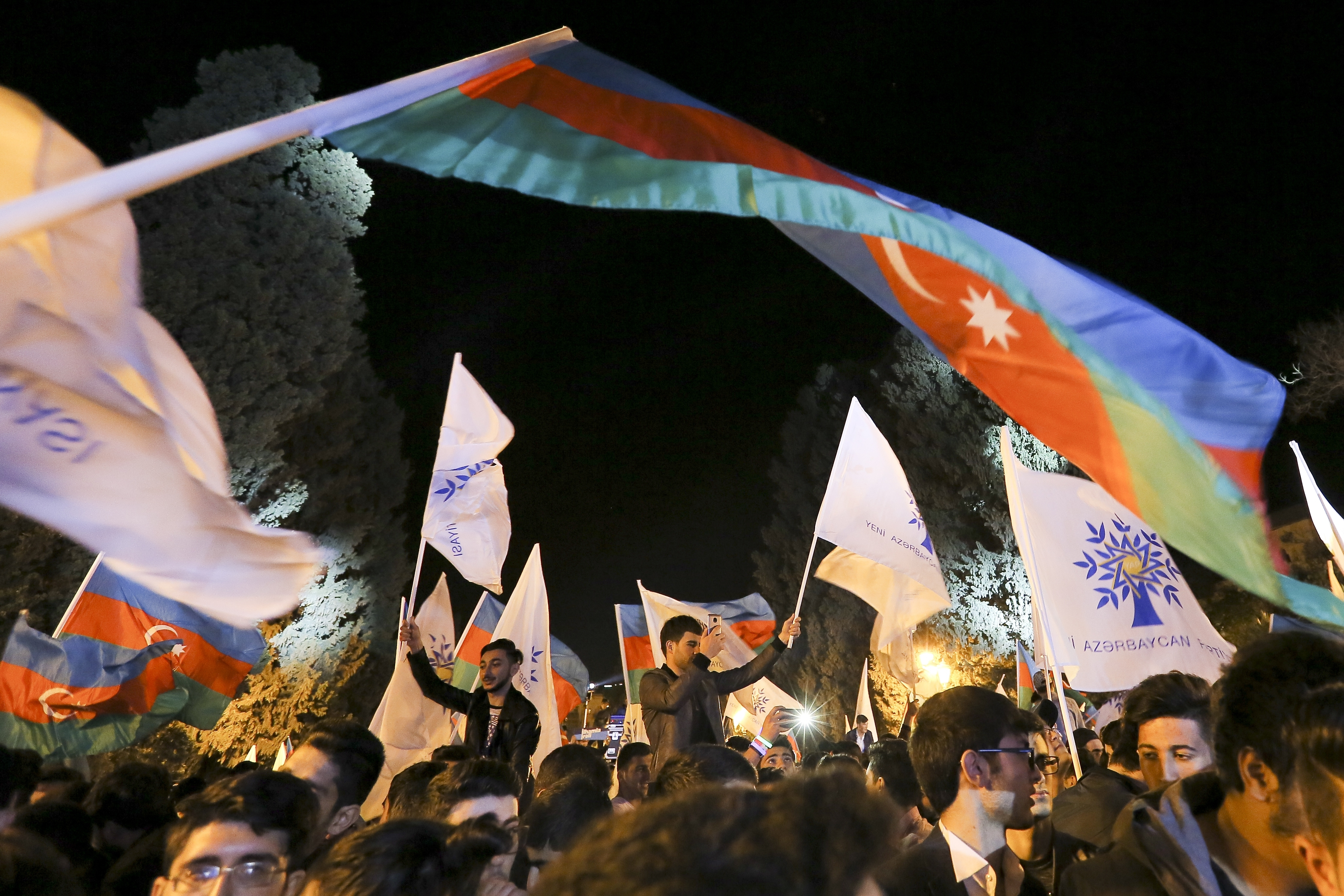 Supporters of Ilham Aliyev celebrate his victory in the presidential elections in Baku