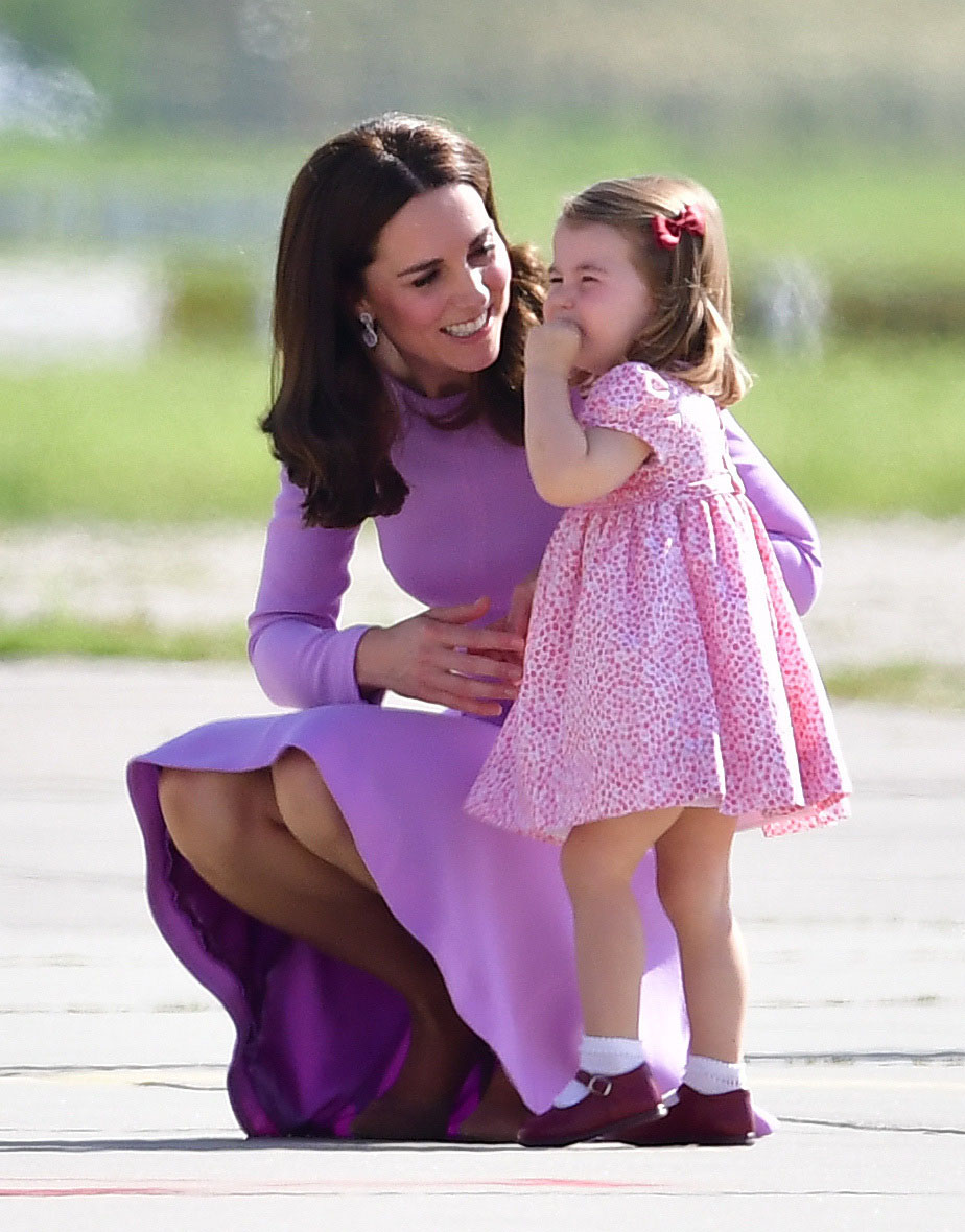 Princess Charlotte with her mother the Duchess of Cambridge as they visit Airbus in Hamburg Germany with the Duke of Cambridge and Prince Geaorge