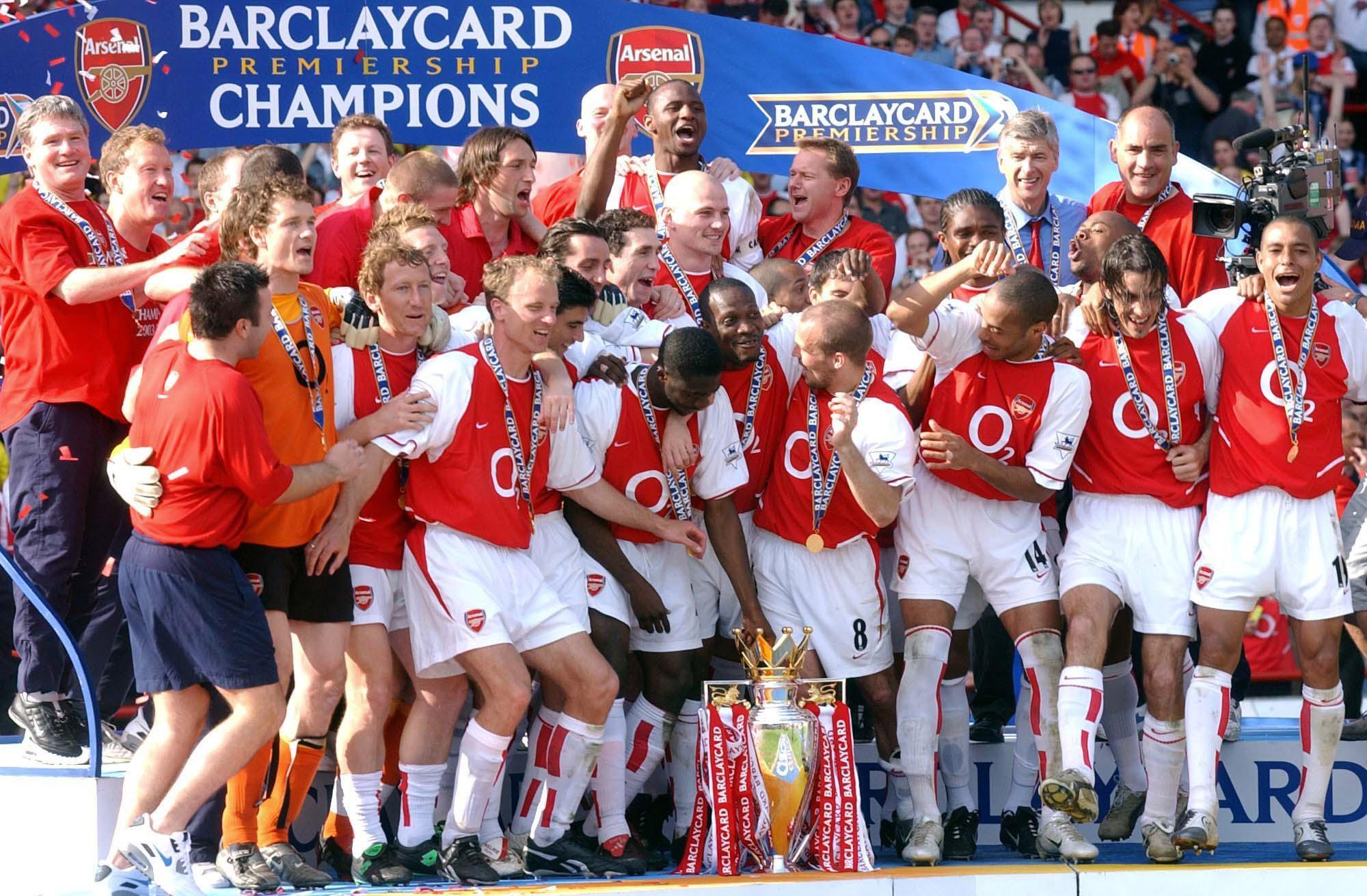 Arsenal's 2003/04 team celebrate winning the Premier League