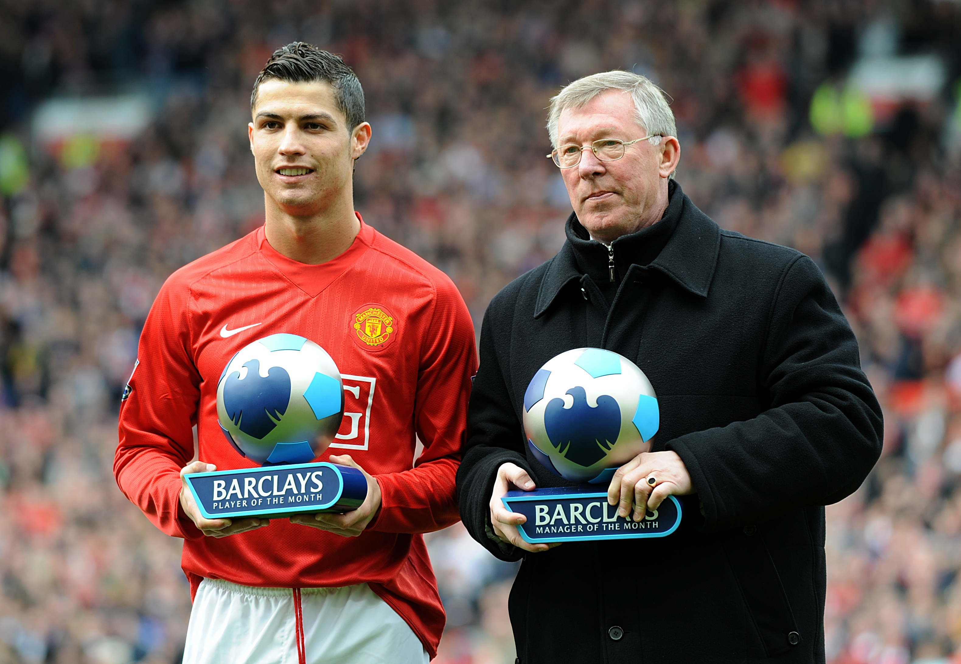 Cristiano Ronaldo and Sir Alex Ferguson receive trophies during their time at Manchester United