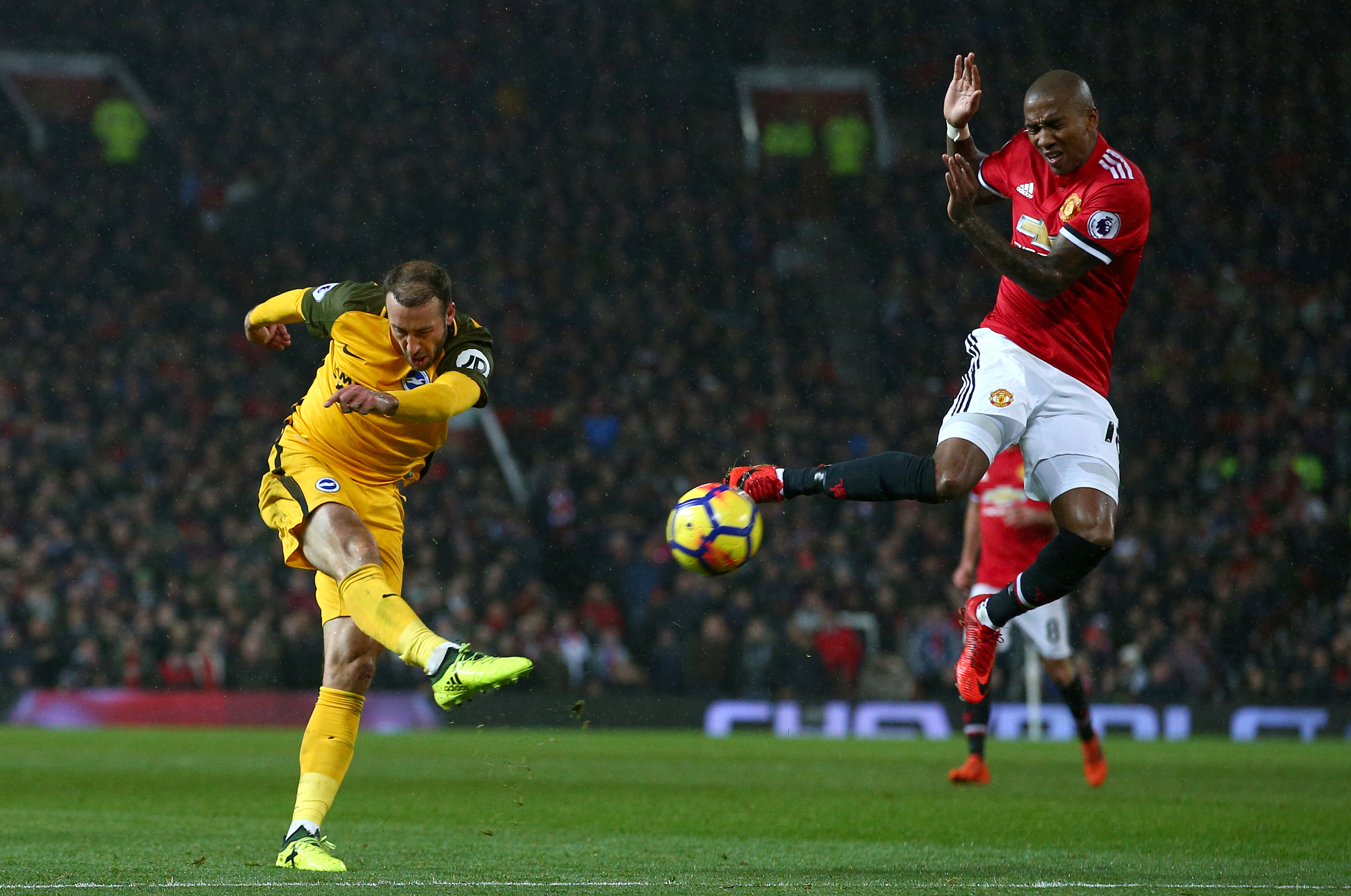Ashley Young goes to block the ball in a game against Brighton