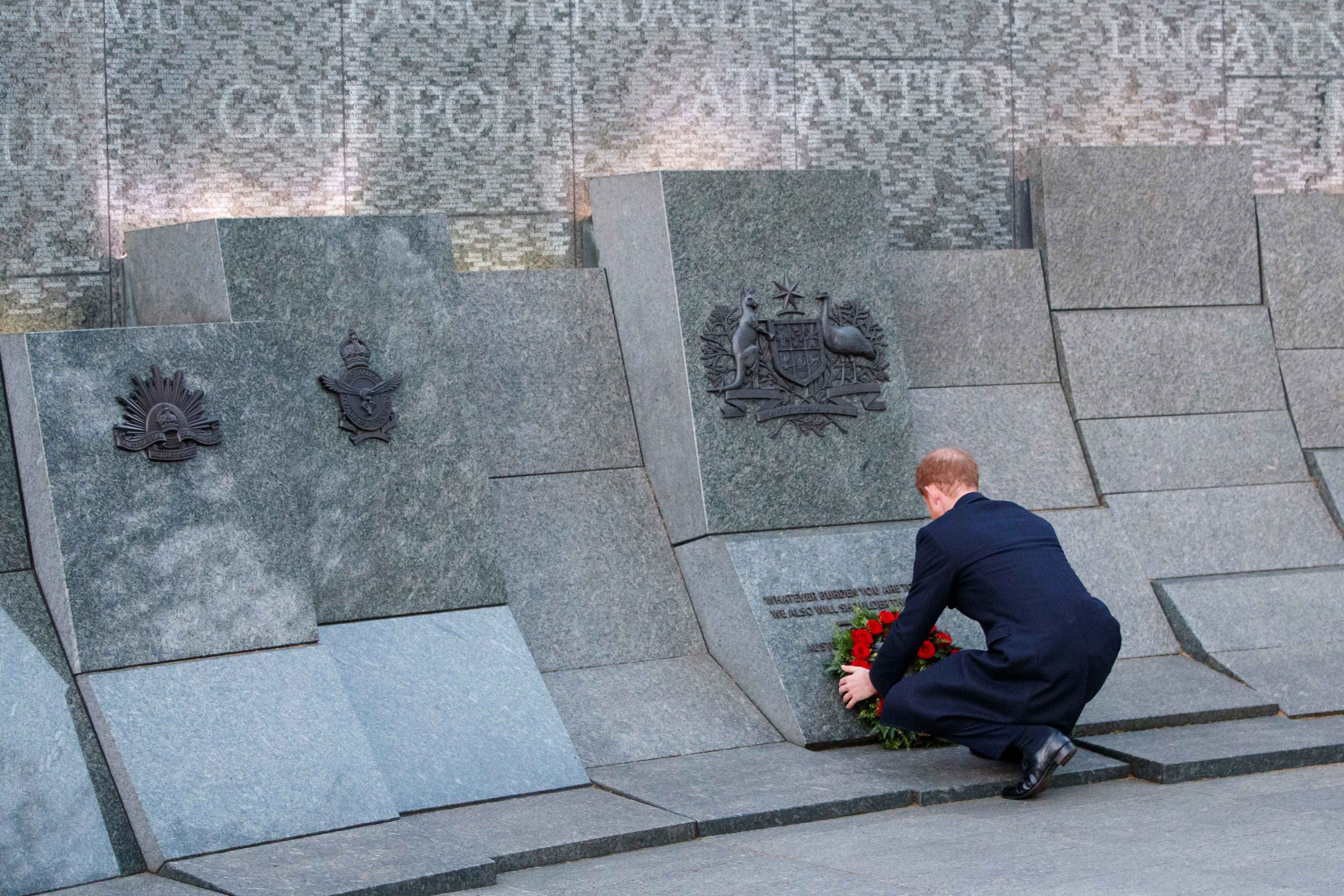 Prince Harry lays a wreath at the Australian War Memorial