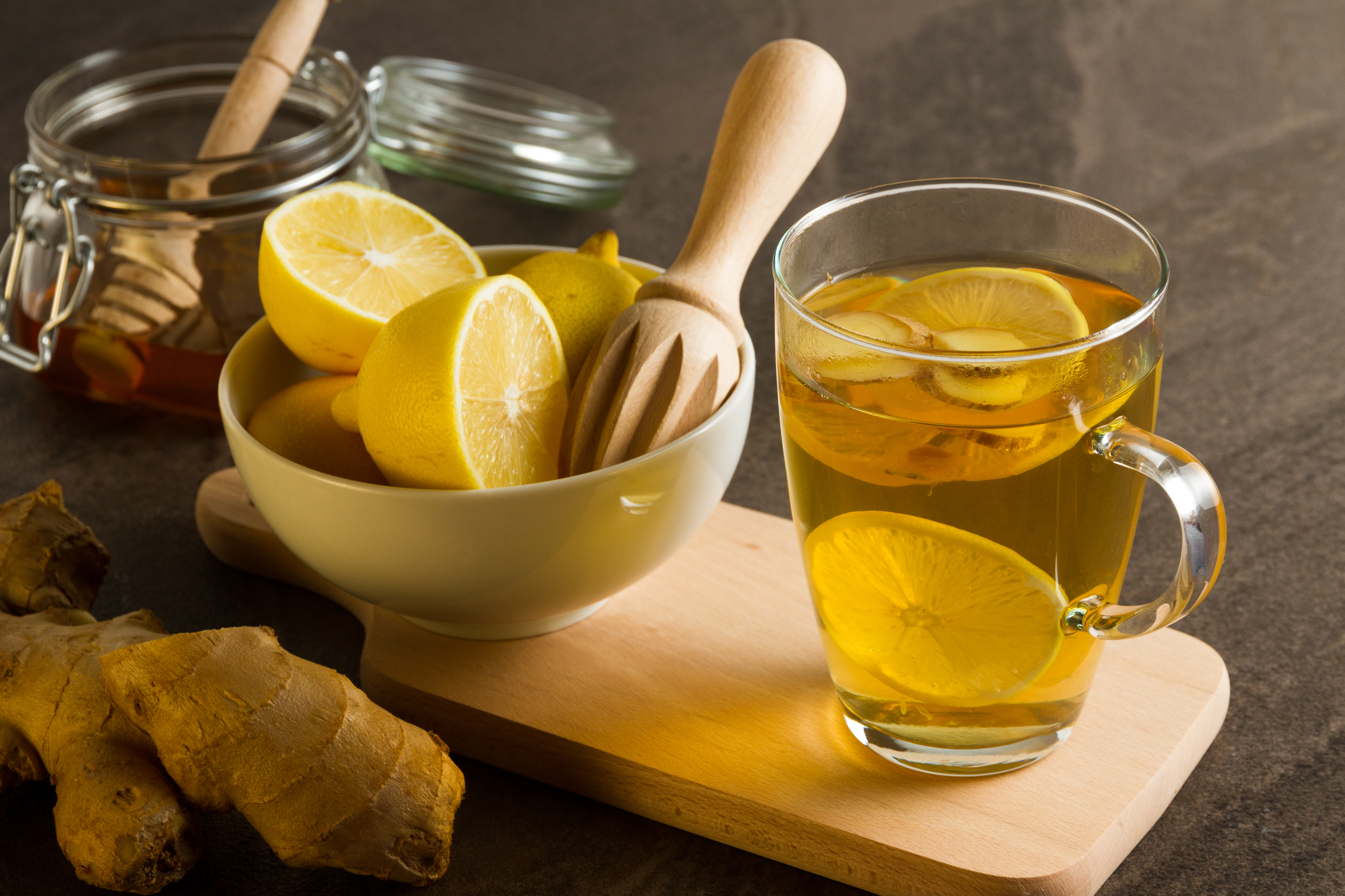 Fresh lemons, ginger and a glass of tea