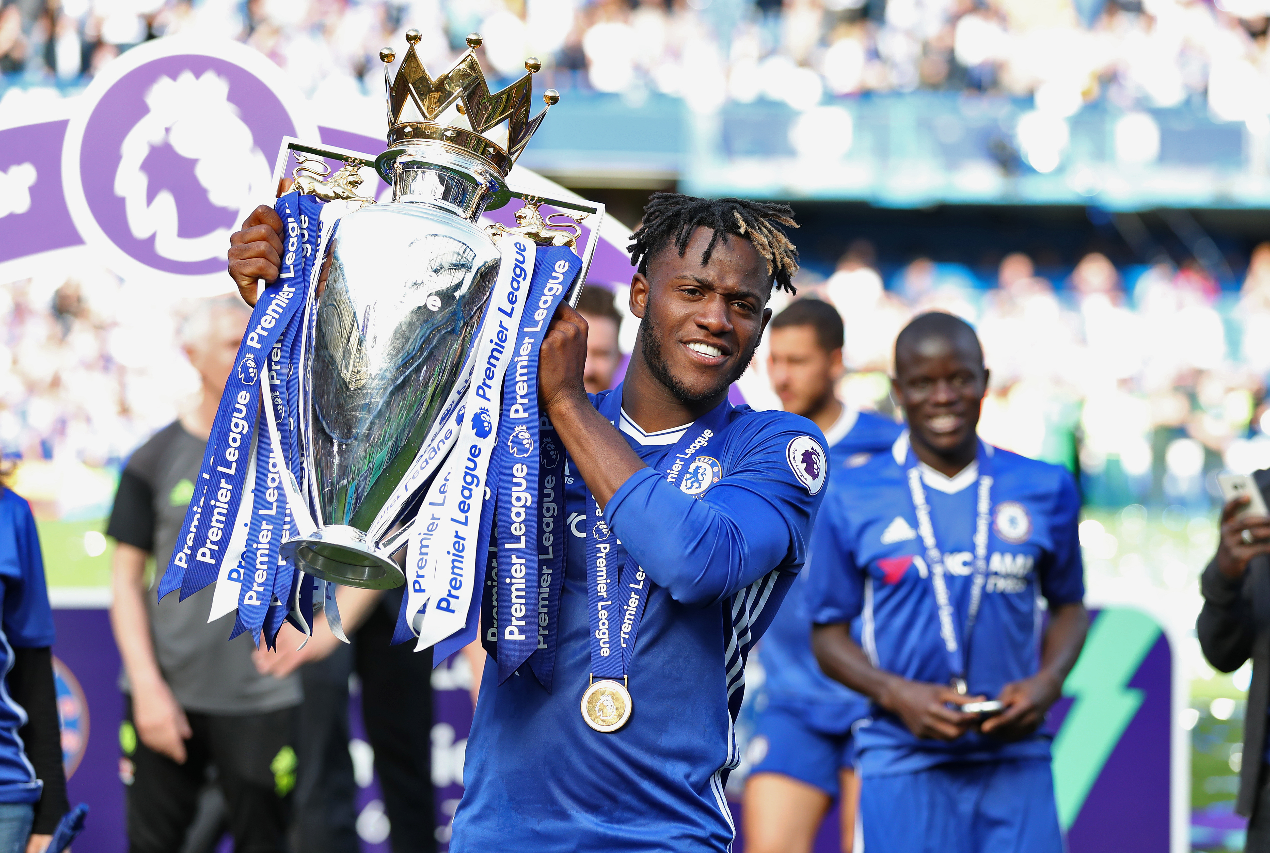 Michy Batshuayi celebrates winning the Premier League title with Chelsea