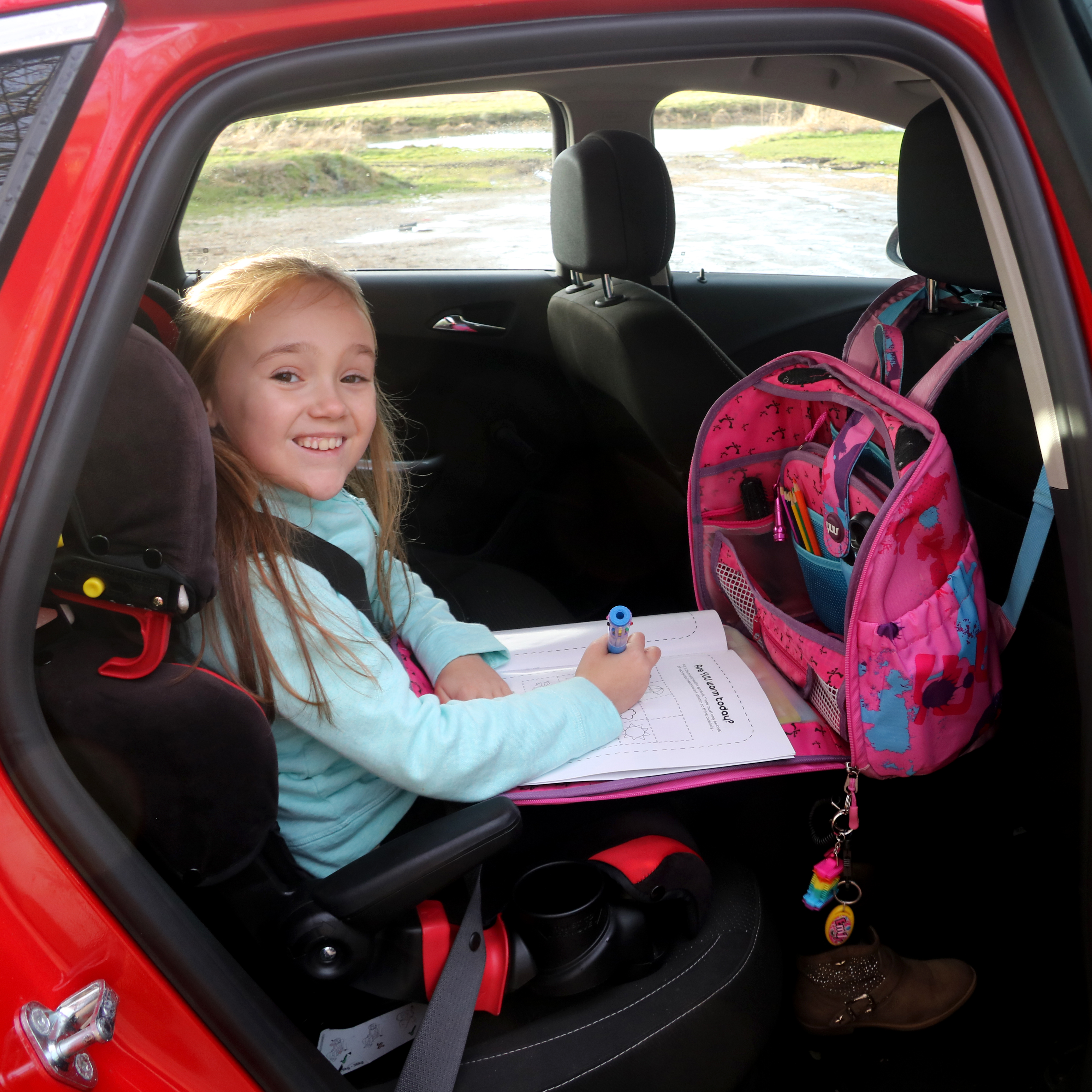 A child in a car with her YUUbag