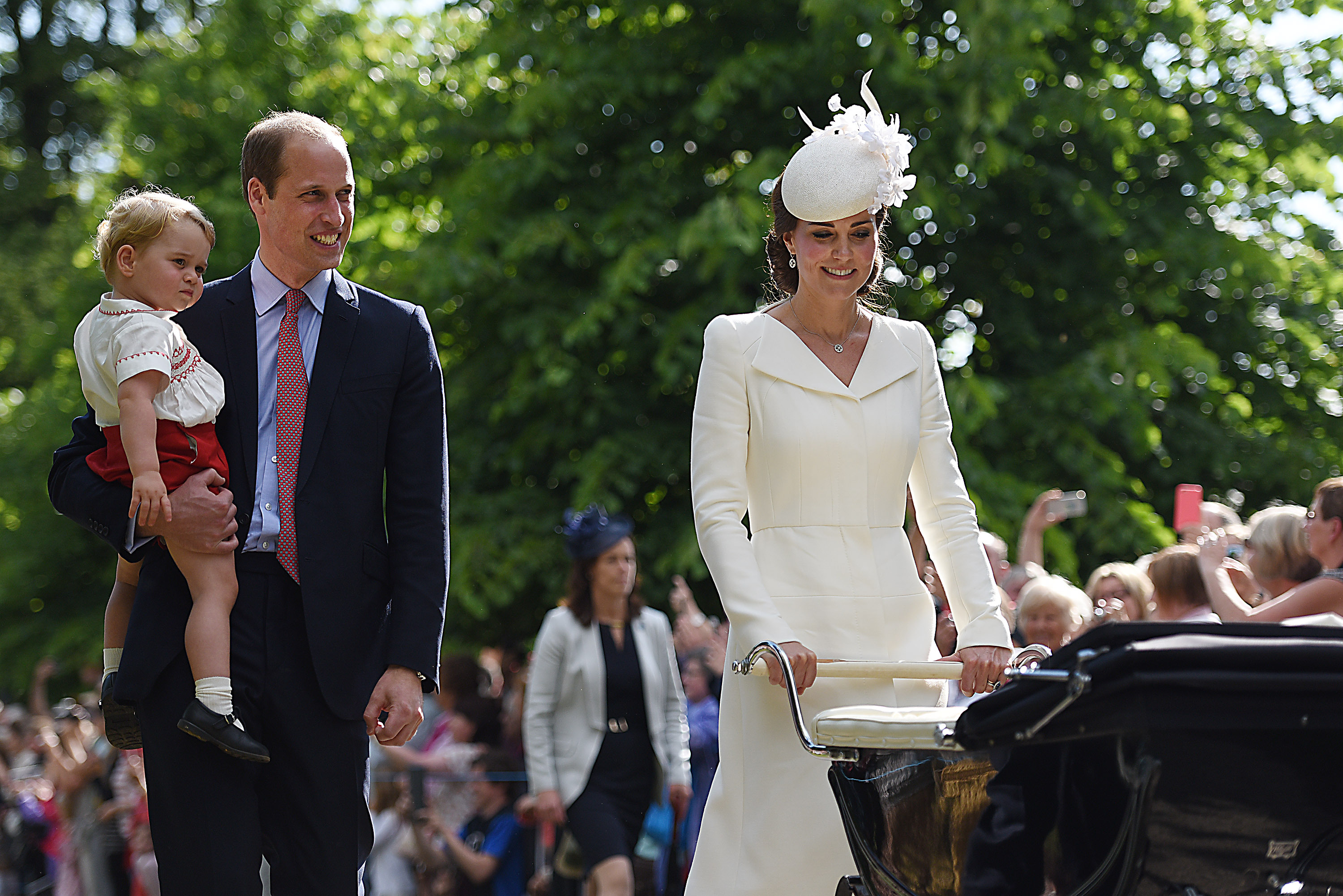 The Duke and Duchess of Cambridge with Prince George and Princess Charlotte (in pram) as they leave the Church of St Mary Magdalene in Sandringham, Norfolk, after Charlotte's christening (Mark Turner/PA)