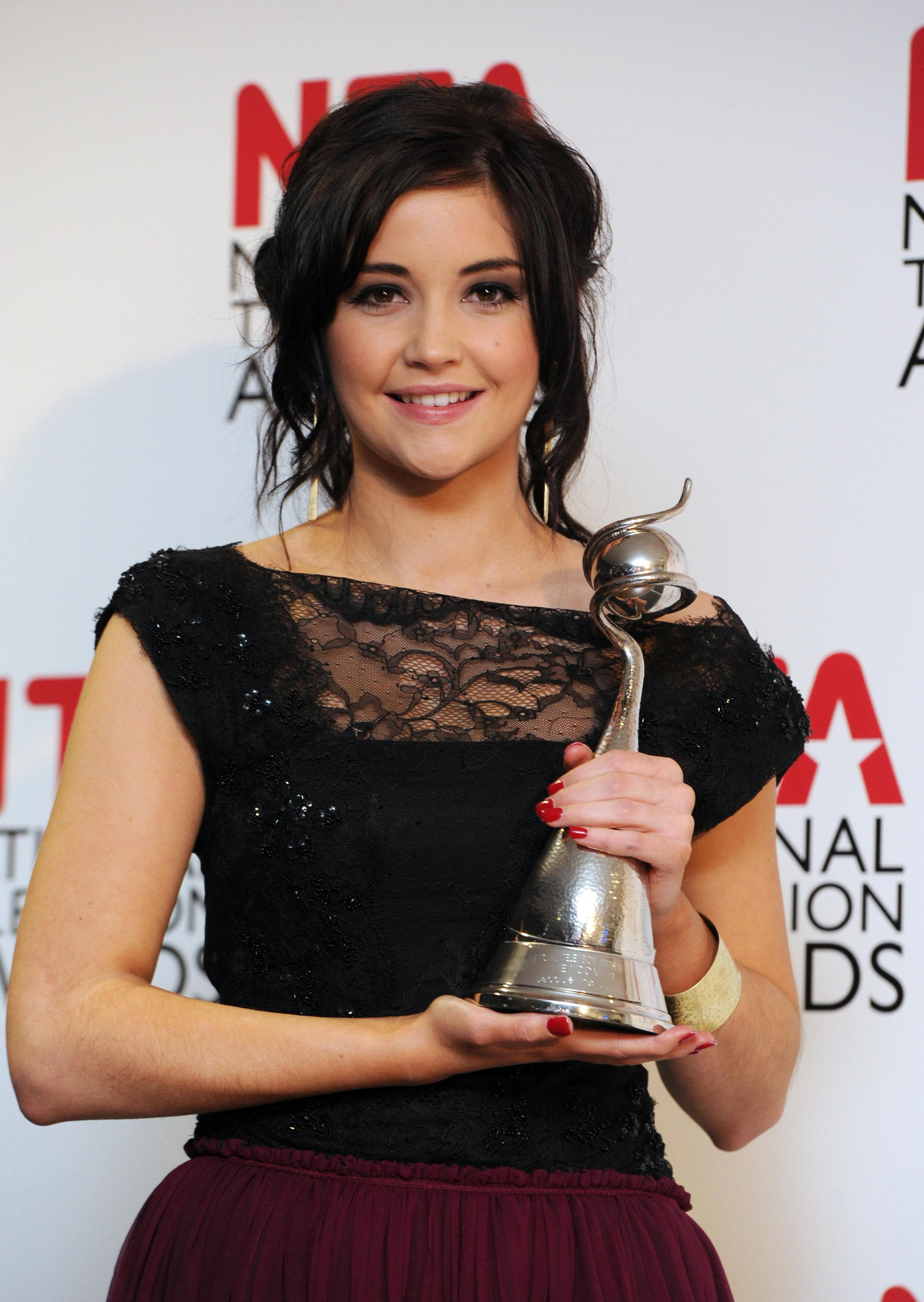 Jacqueline Jossa holds her Newcomer award received at the National Television Awards 2012. (Anthony Devlin/PA)